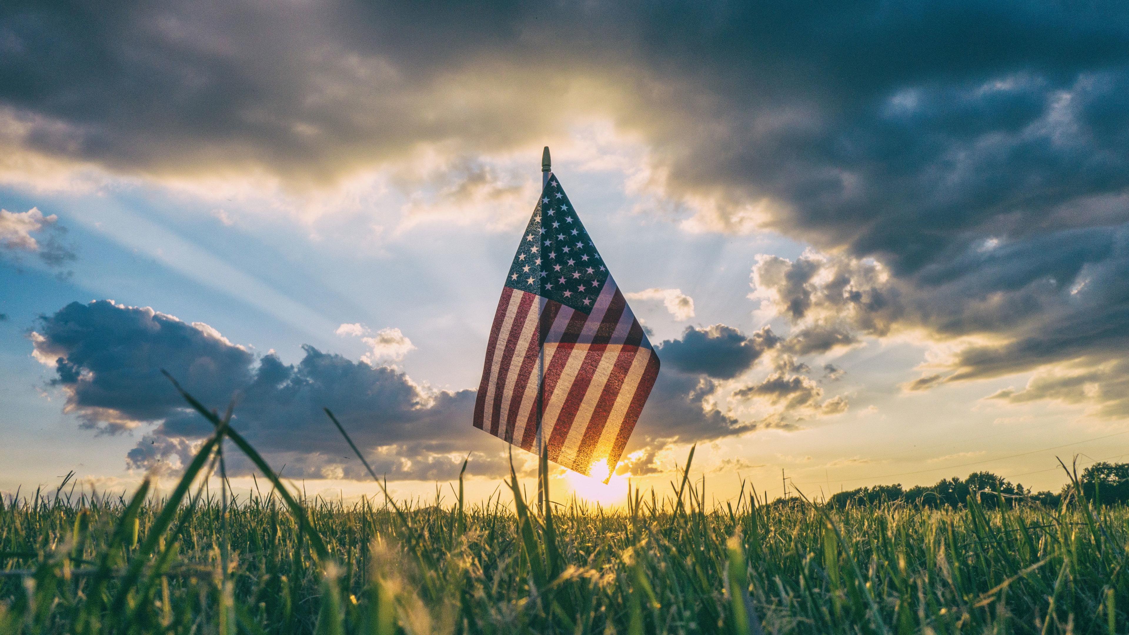 america flag inside field grass 4k 1538069349 - America Flag Inside Field Grass 4k - world wallpapers, hd-wallpapers, grass wallpapers, flag wallpapers, field wallpapers, america wallpapers, 4k-wallpapers