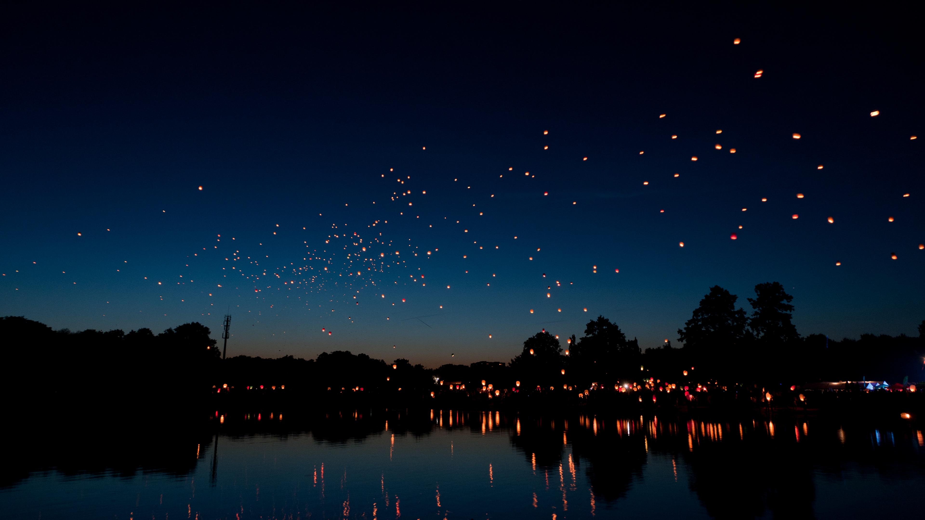 chinese lanterns sky lanterns night river holiday 4k 1538068533
