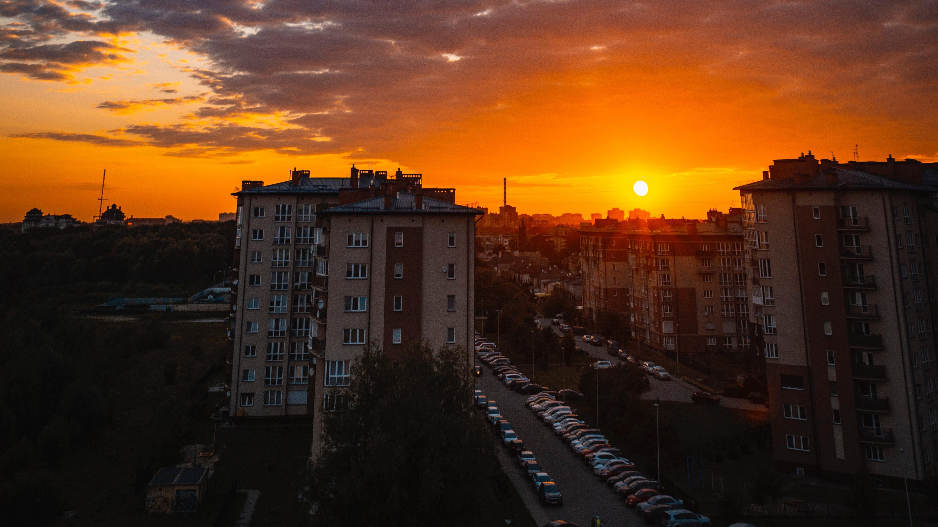 city buildings sunset clouds parking 4k 1538066682 - city, buildings, sunset, clouds, parking 4k - sunset, City, buildings