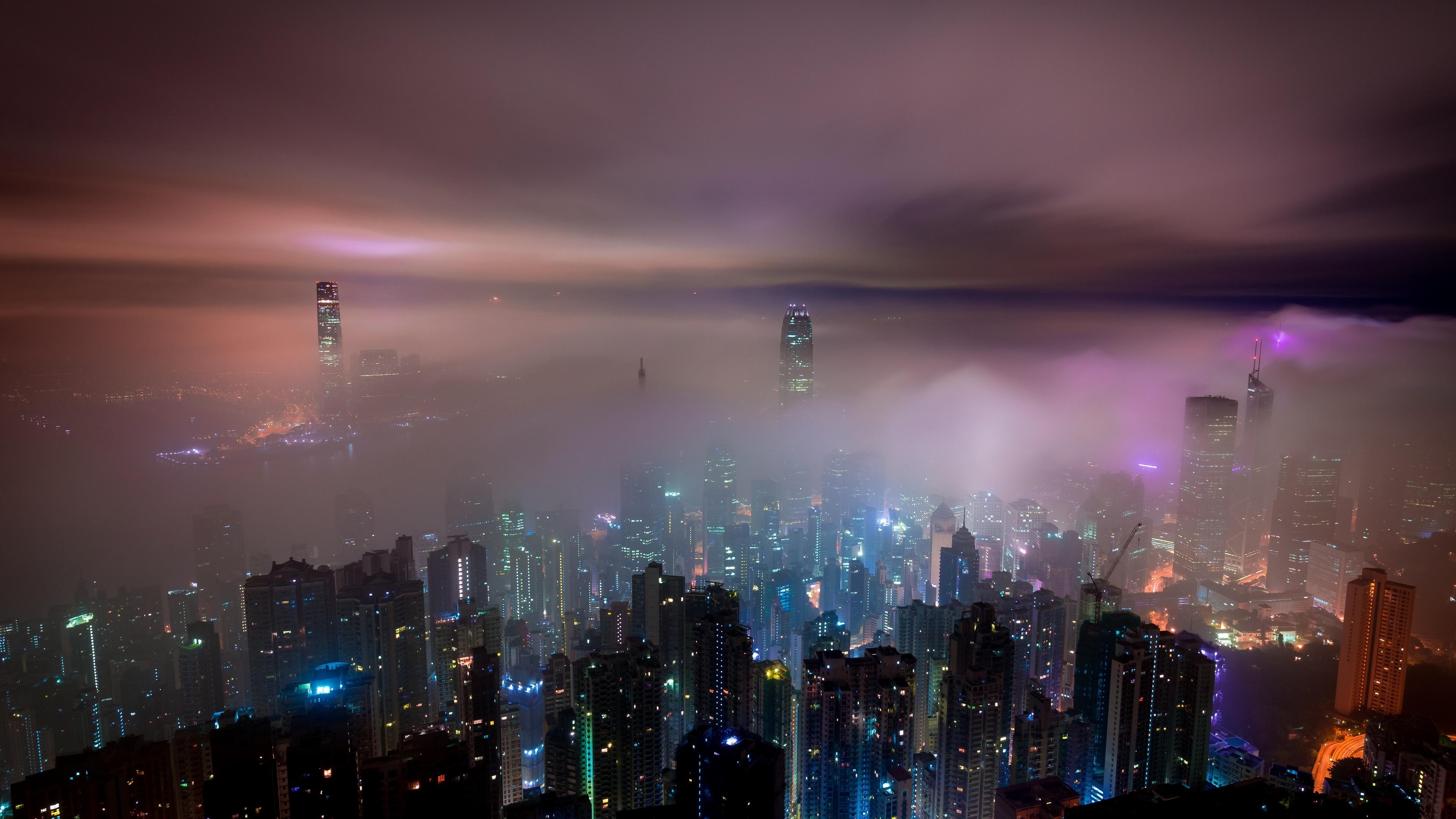 hong kong buildings night lights mist 1538069334 - Hong Kong Buildings Night Lights Mist - world wallpapers, mist wallpapers, lights wallpapers, hong kong wallpapers, hd-wallpapers, city wallpapers, buildings wallpapers, 5k wallpapers, 4k-wallpapers