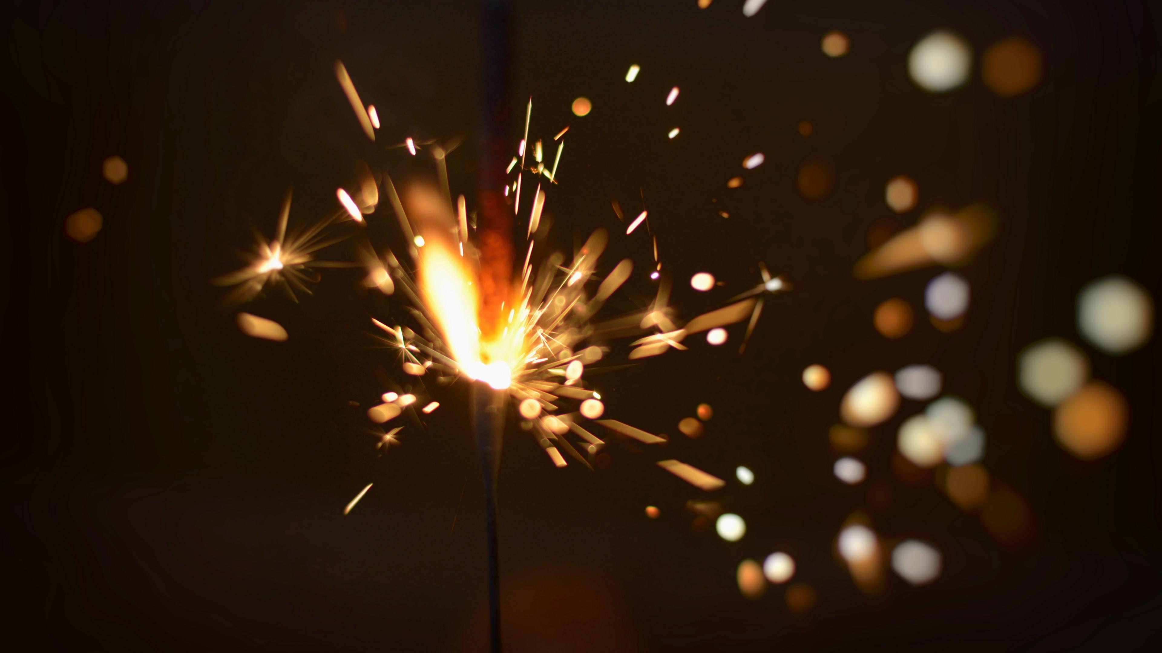 sparkler sparks glare 4k 1538344797 - sparkler, sparks, glare 4k - Sparks, sparkler, glare