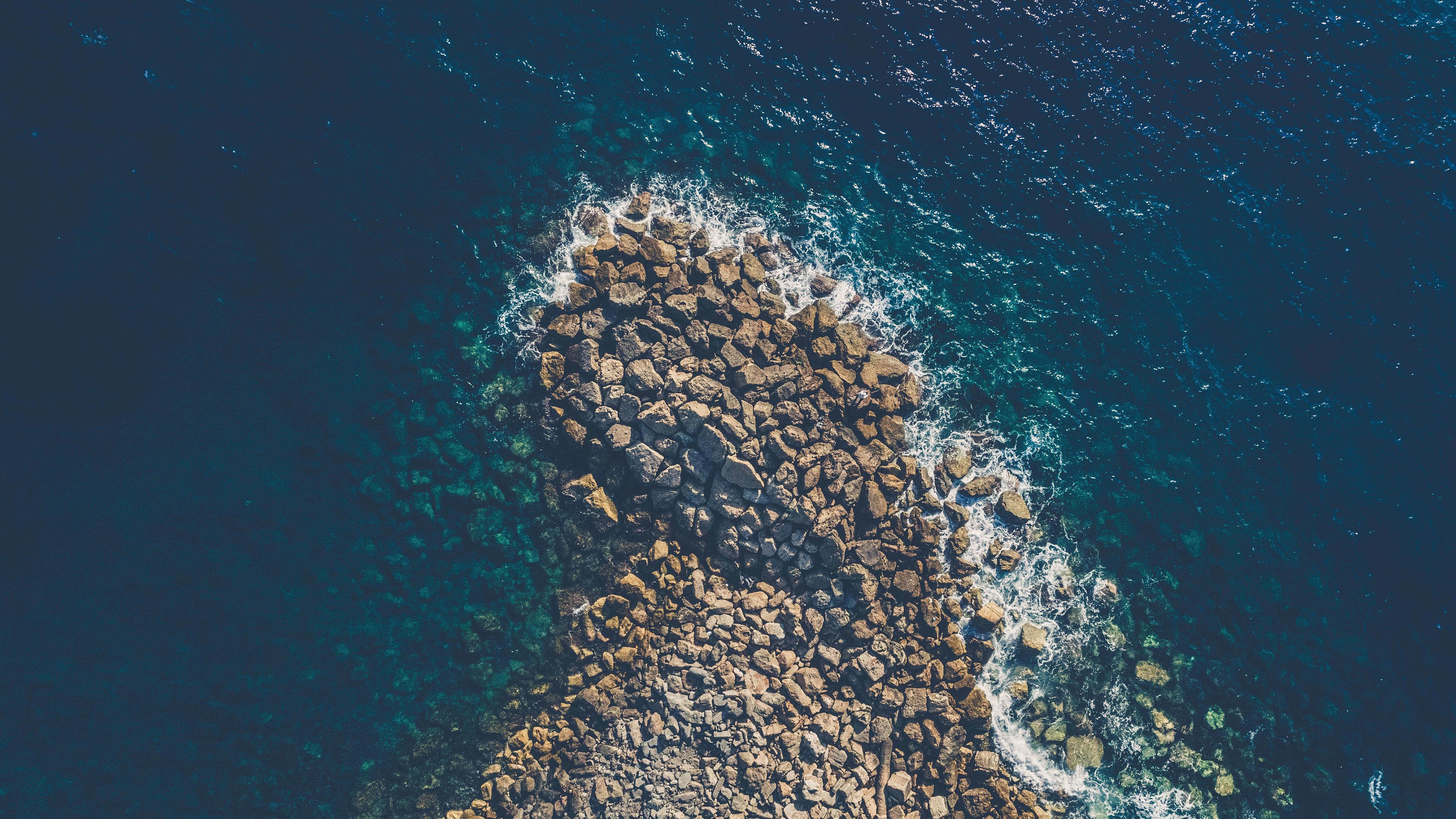 aeiral view sea water coast rocks 4k 1540133047 - Aeiral View Sea Water Coast Rocks 4k - water wallpapers, sea wallpapers, rocks wallpapers, nature wallpapers, hd-wallpapers, 5k wallpapers, 4k-wallpapers