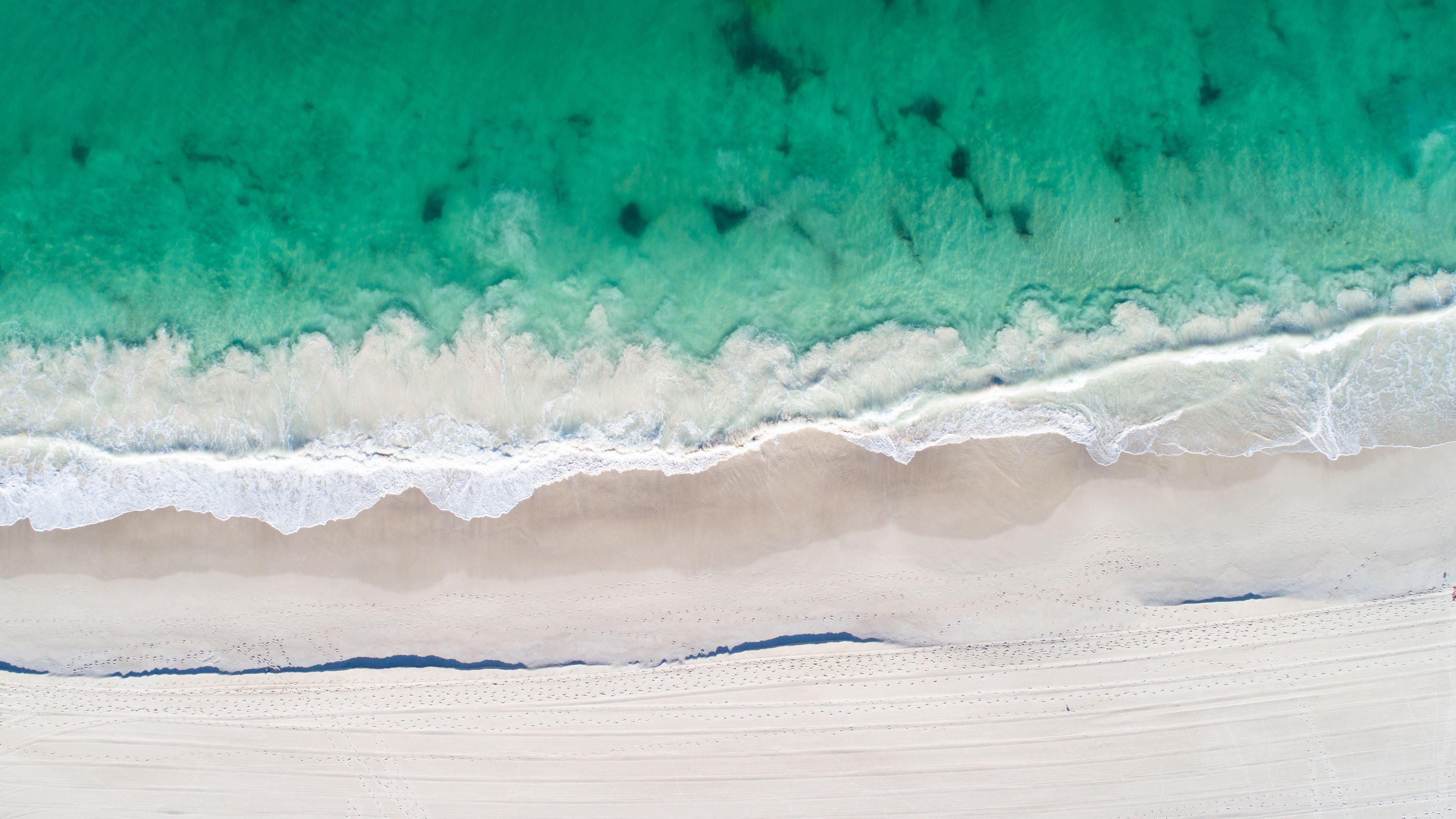 aerial view of beach clear ocaen sand 5k 1540142939 - Aerial View Of Beach Clear Ocaen Sand 5k - sand wallpapers, ocean wallpapers, nature wallpapers, hd-wallpapers, clouds wallpapers, beach wallpapers, aerial wallpapers, 5k wallpapers, 4k-wallpapers