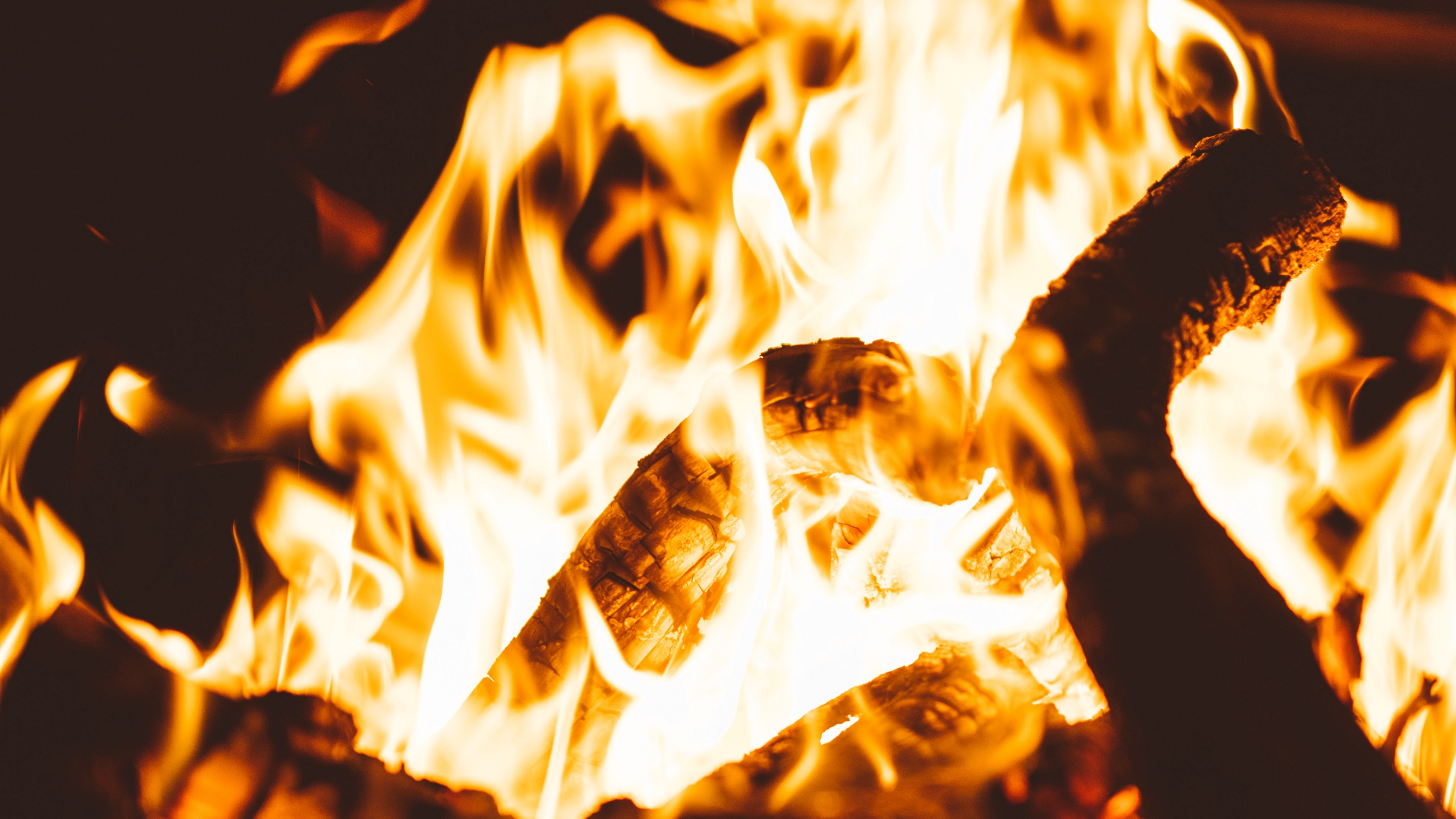 bonfire fire flame firewood dark blur 4k 1540575227 - bonfire, fire, flame, firewood, dark, blur 4k - flame, Fire, bonfire