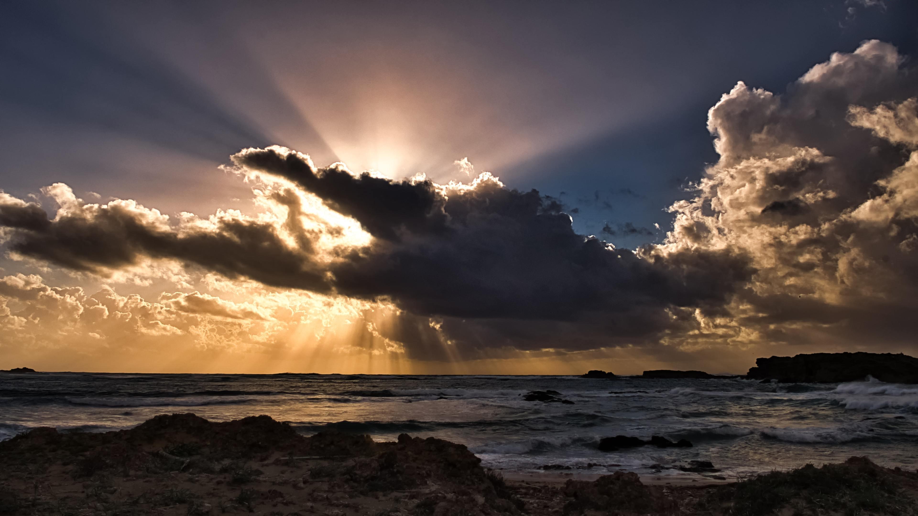 clouds sun rays passing ocean 4k 1540141093 - Clouds Sun Rays Passing Ocean 4k - sunbeam wallpapers, storm wallpapers, sky wallpapers, ocean wallpapers, nature wallpapers, hd-wallpapers, clouds wallpapers, 5k wallpapers, 4k-wallpapers