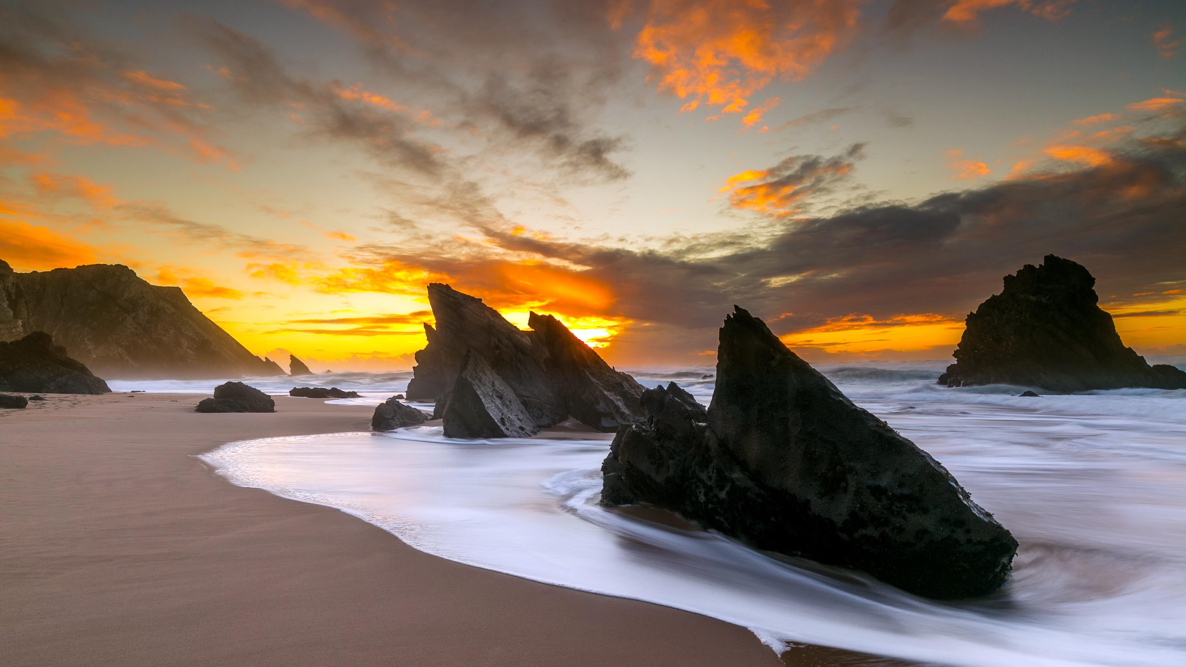 large rocks on beach shore 4k 1540136340 - Large Rocks On Beach Shore 4k - sunset wallpapers, sunrise wallpapers, shore wallpapers, rocks wallpapers, nature wallpapers, hd-wallpapers, dusk wallpapers, dawn wallpapers, beach wallpapers, 4k-wallpapers