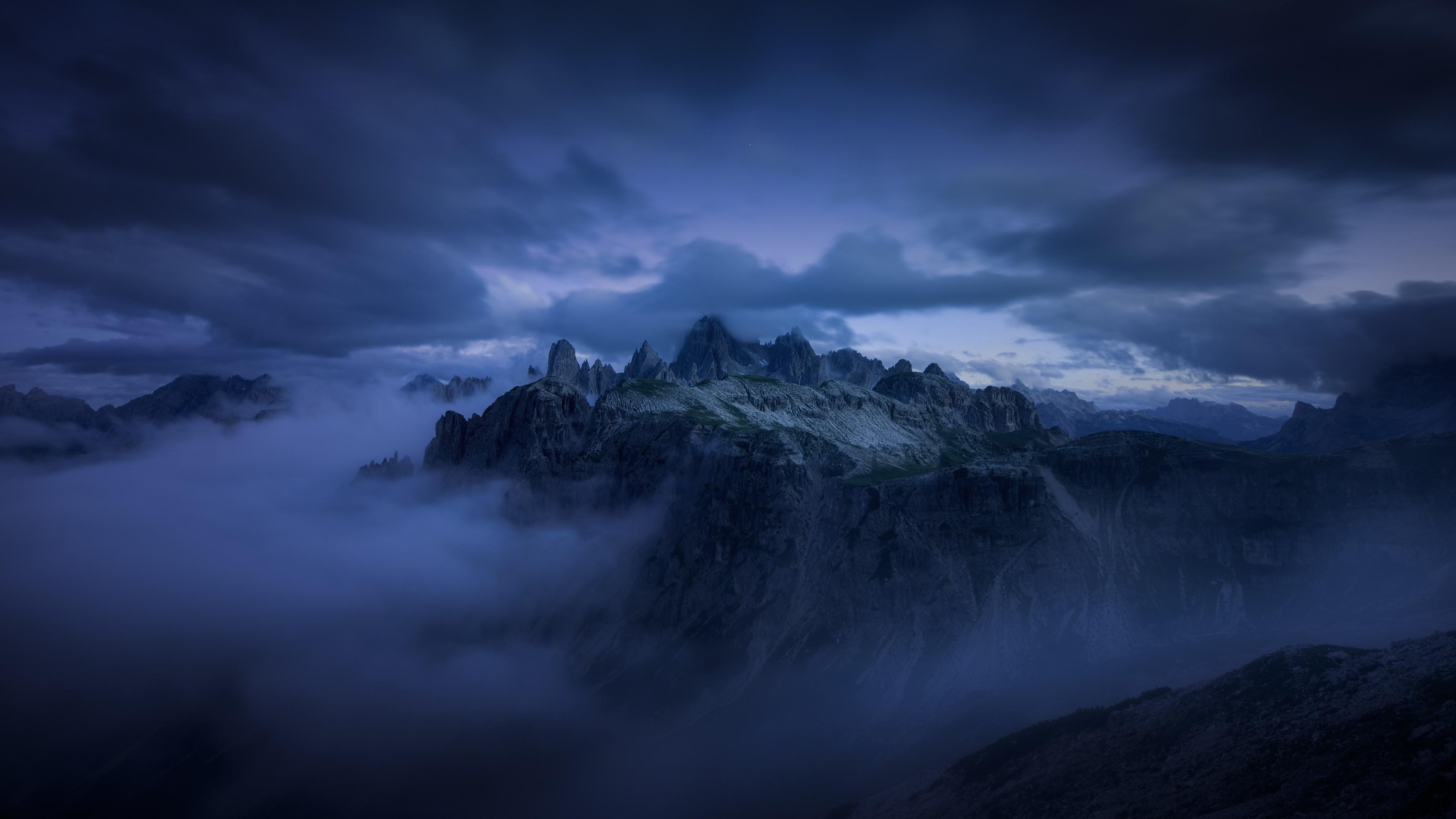 mountains cliff covered under fog mist 5k 1540143633 - Mountains Cliff Covered Under Fog Mist 5k - nature wallpapers, mountains wallpapers, mist wallpapers, hd-wallpapers, fog wallpapers, blue wallpapers, 4k-wallpapers