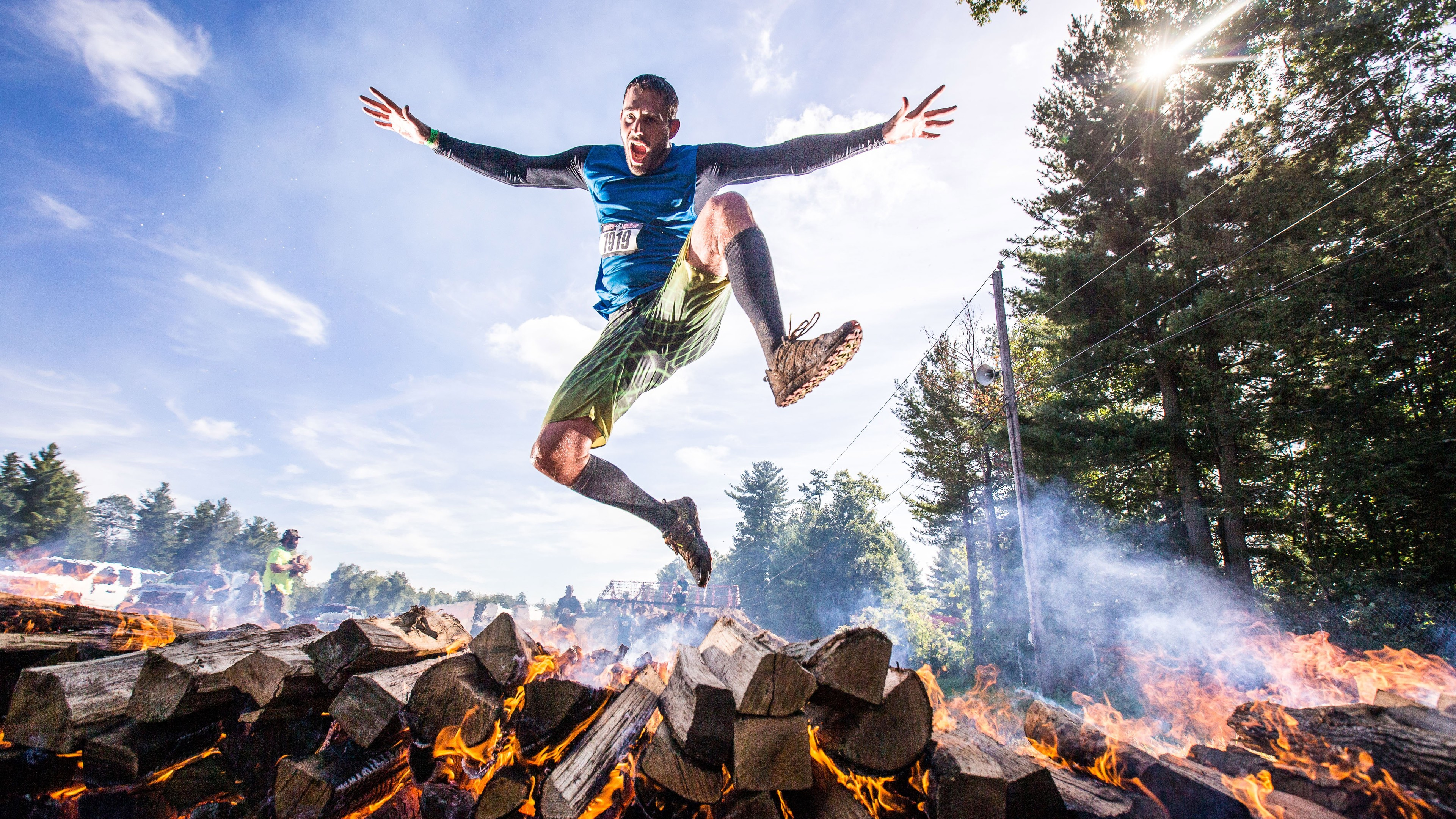 player jumping out of burning woods 1538787003 - Player Jumping Out Of Burning Woods - sports wallpapers, running wallpapers, others wallpapers, jump wallpapers, hd-wallpapers, 5k wallpapers, 4k-wallpapers