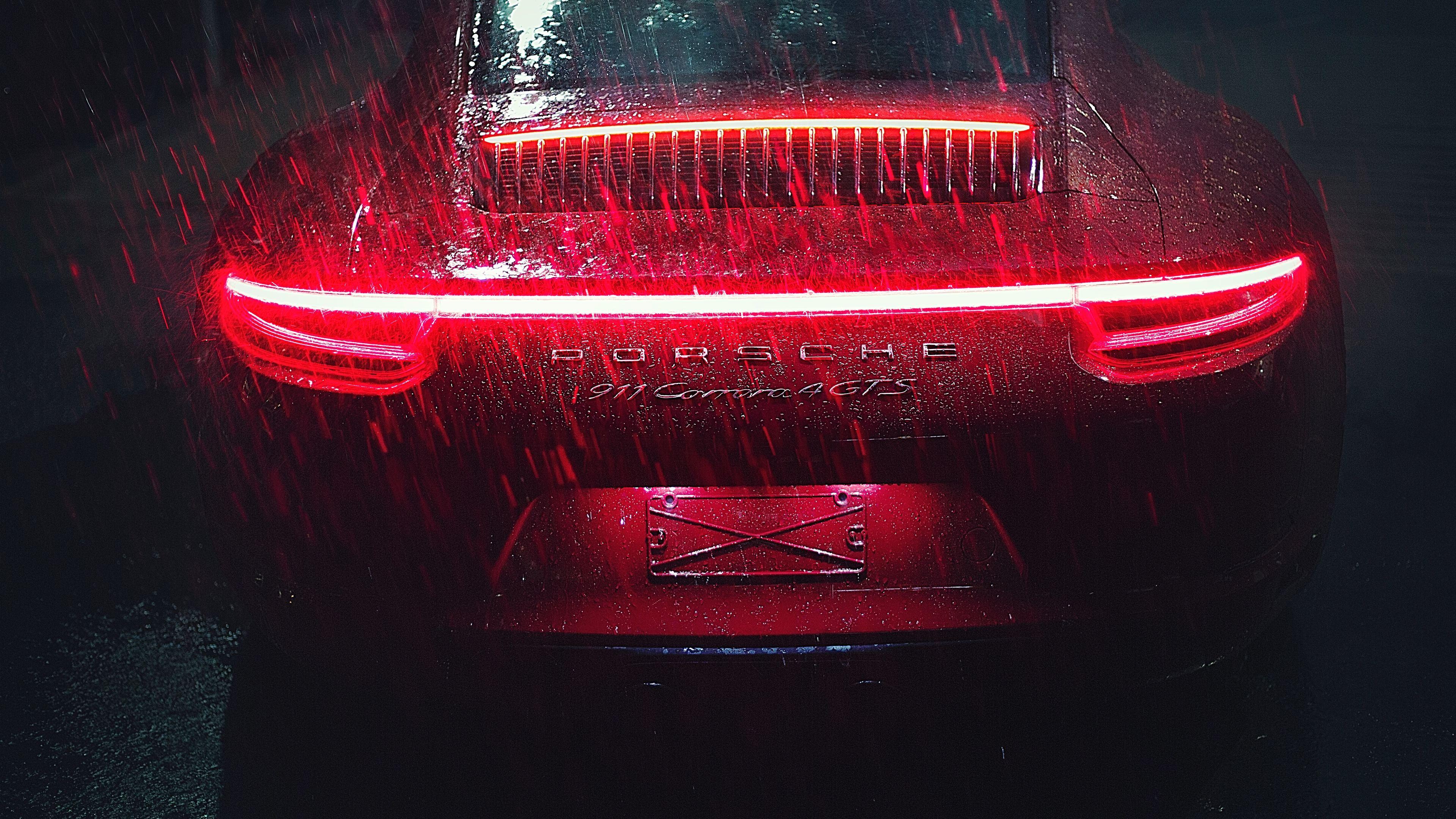 porsche 911 carrera tail light raining 1539110422 - Porsche 911 Carrera Tail Light Raining - rain wallpapers, porsche wallpapers, porsche 911 wallpapers, hd-wallpapers, cars wallpapers, 5k wallpapers, 4k-wallpapers, 2018 cars wallpapers