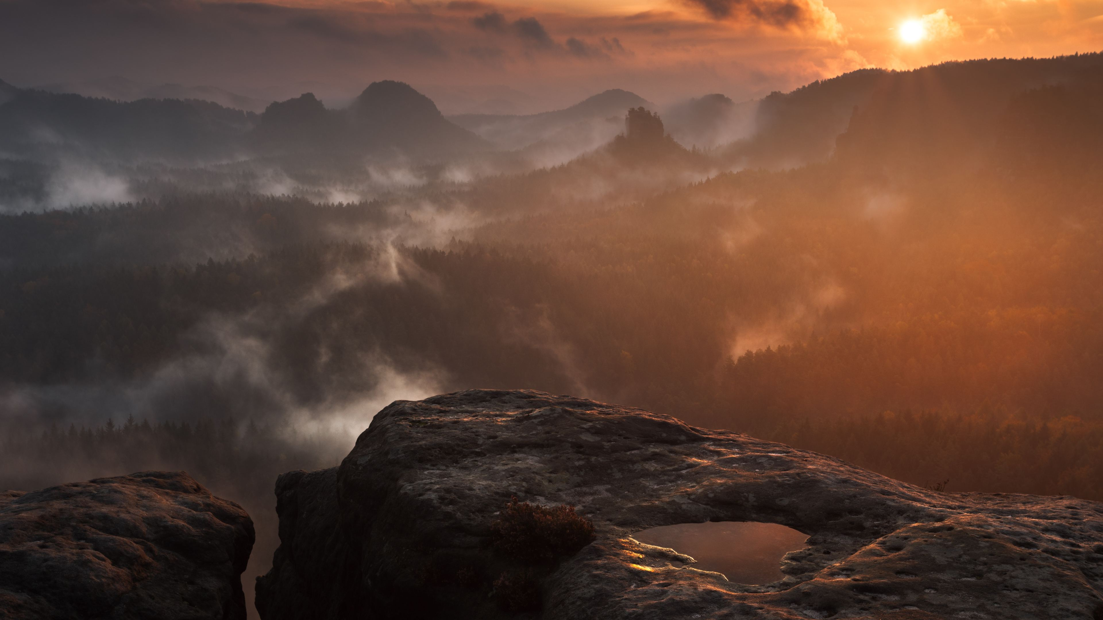 rock hill fog clouds forest sunset 4k 1540144776 - Rock Hill Fog Clouds Forest Sunset 4k - sunset wallpapers, rocks wallpapers, nature wallpapers, hd-wallpapers, forest wallpapers, fog wallpapers, clouds wallpapers, 5k wallpapers, 4k-wallpapers