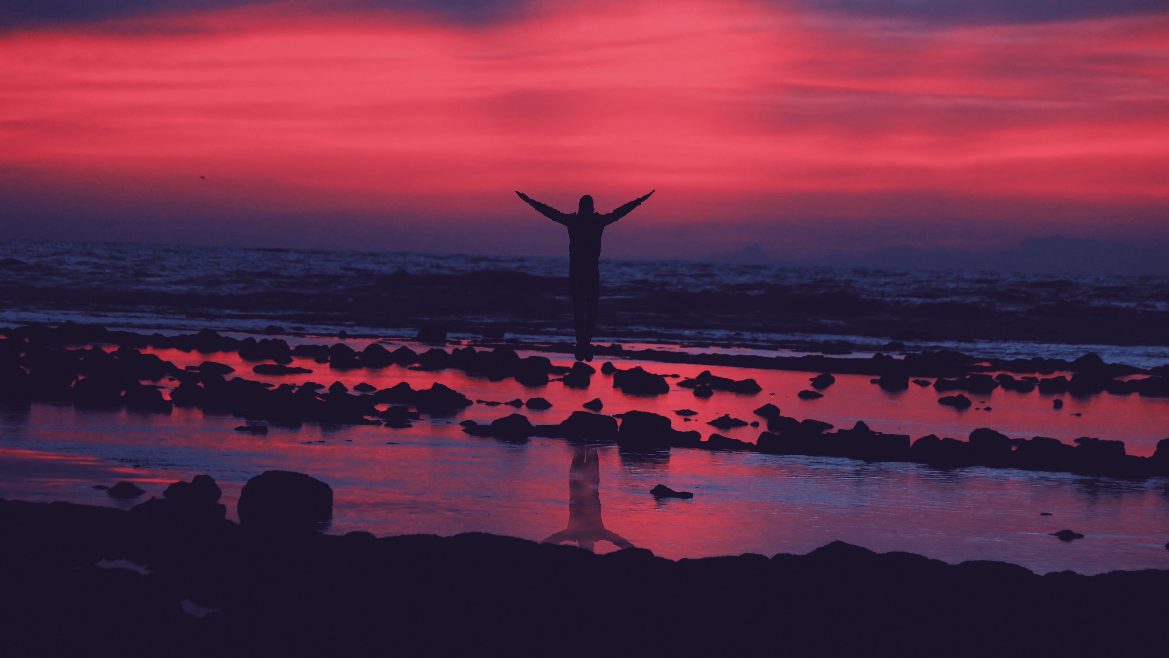 shore guy jump stones sunset 4k 1540574494 - shore, guy, jump, stones, sunset 4k - Shore, jump, guy