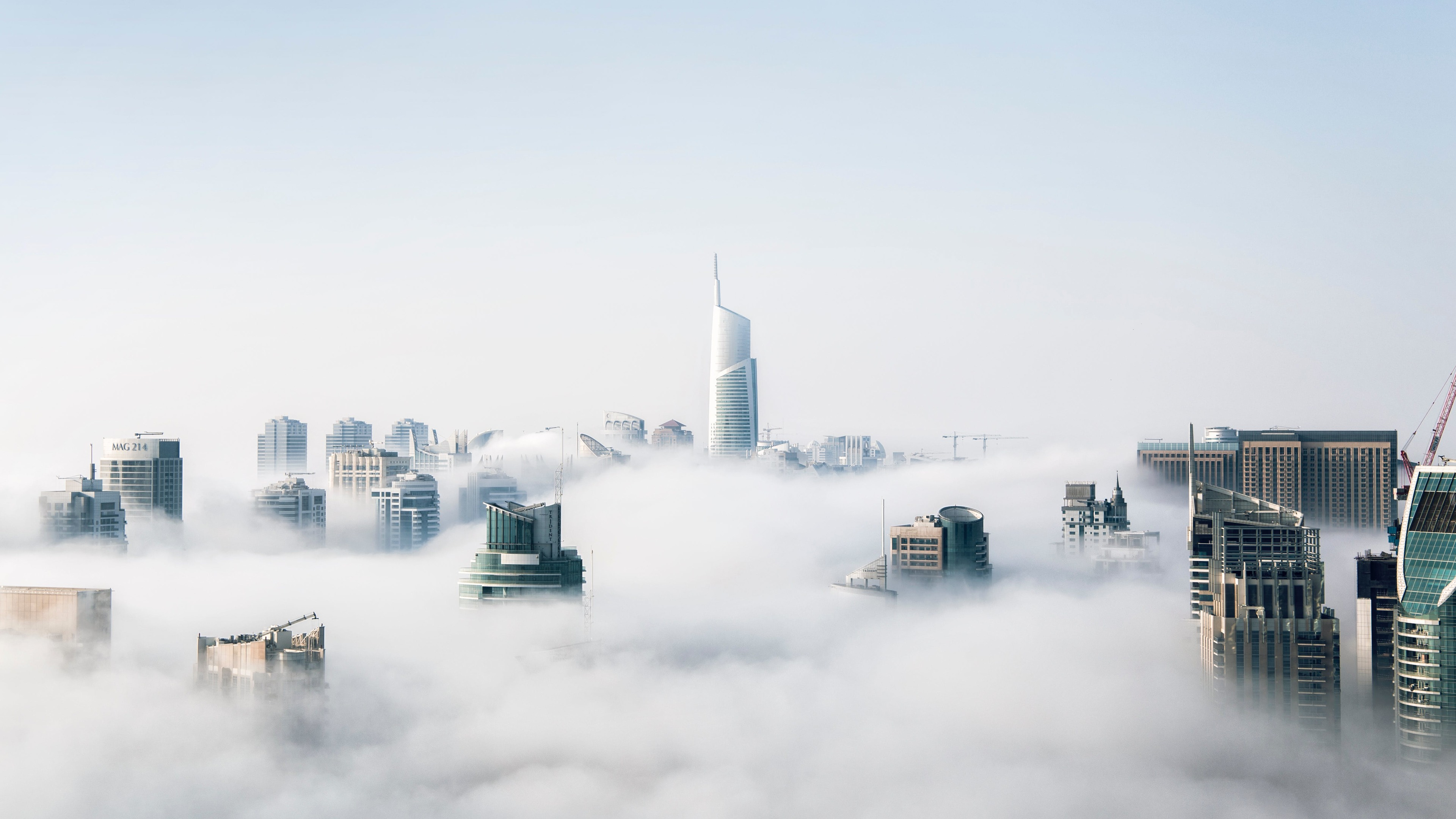 skyscraper buildings covered in fog 1540143654 - Skyscraper Buildings Covered In Fog - skyscraper wallpapers, nature wallpapers, hd-wallpapers, fog wallpapers, cityscape wallpapers, buildings wallpapers, 4k-wallpapers
