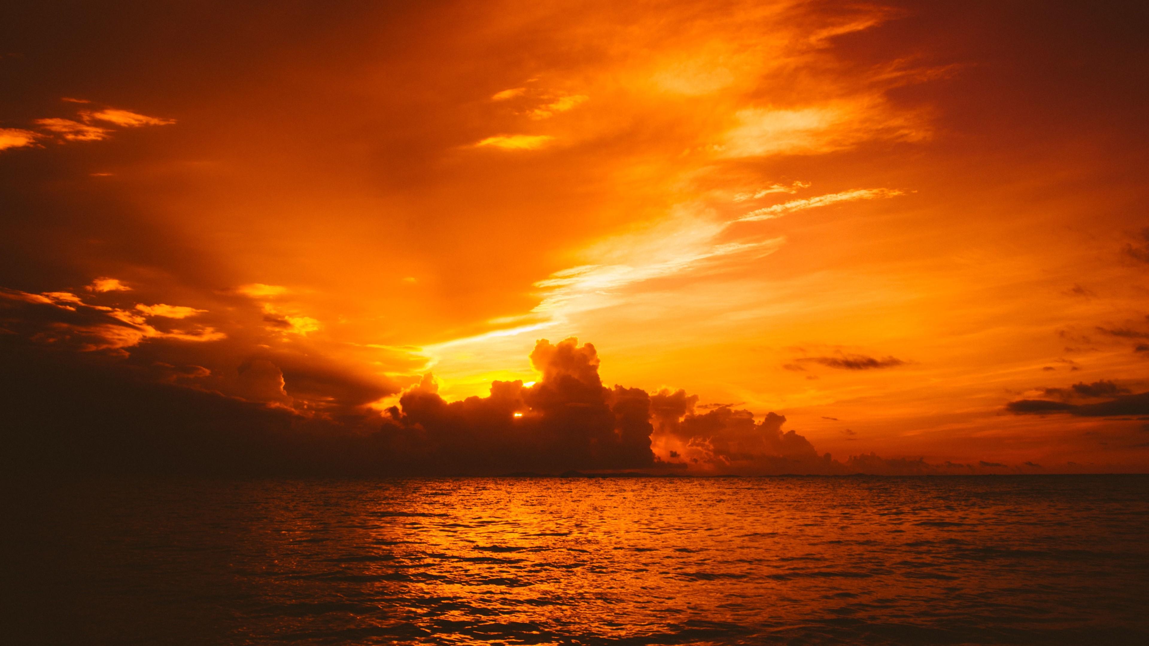 sun in clouds sea nature 4k 1540139445 - Sun In Clouds Sea Nature 4k - sunset wallpapers, sunrise wallpapers, sea wallpapers, nature wallpapers, hd-wallpapers, clouds wallpapers, 5k wallpapers, 4k-wallpapers