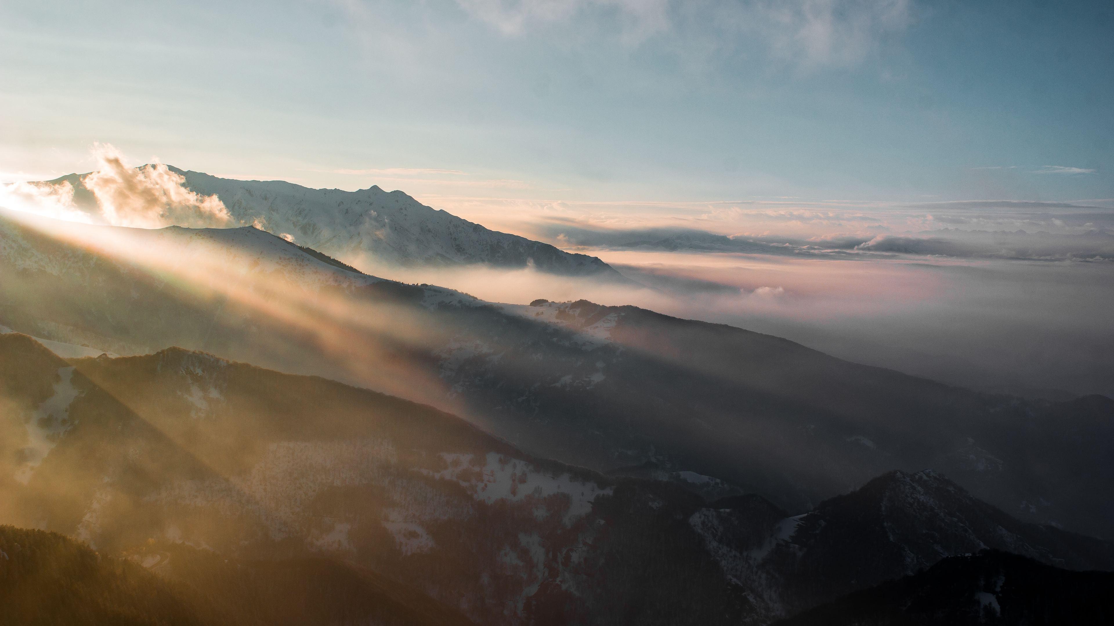 sun rays through mountains 1540140959 - Sun Rays Through Mountains - sunbeam wallpapers, nature wallpapers, mountains wallpapers, hd-wallpapers, 4k-wallpapers