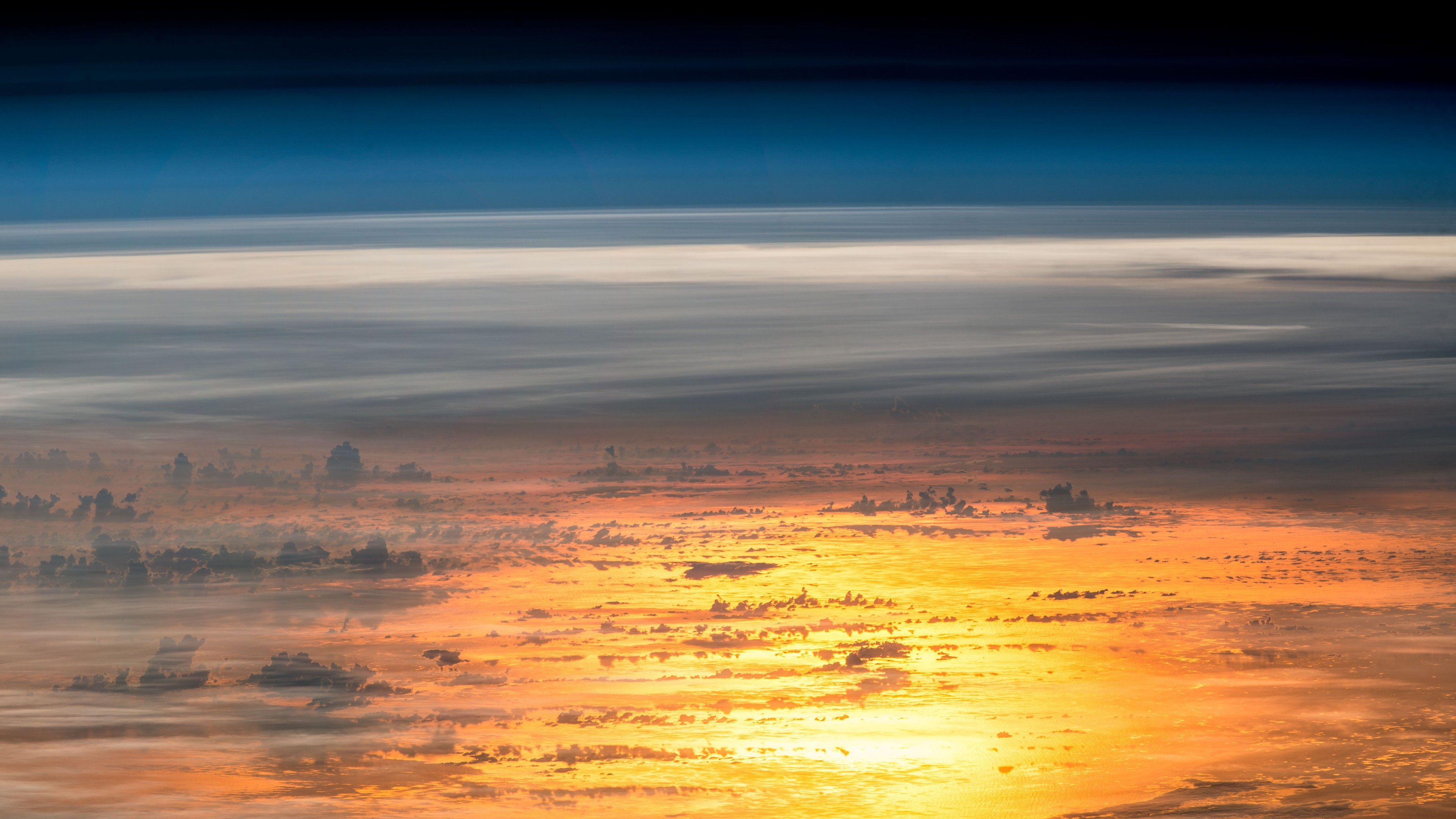 sunset from the international space station 1540140933 - Sunset From The International Space Station - space wallpapers, sky wallpapers, reflection wallpapers, nature wallpapers, horizon wallpapers, hd-wallpapers, clouds wallpapers, 5k wallpapers, 4k-wallpapers