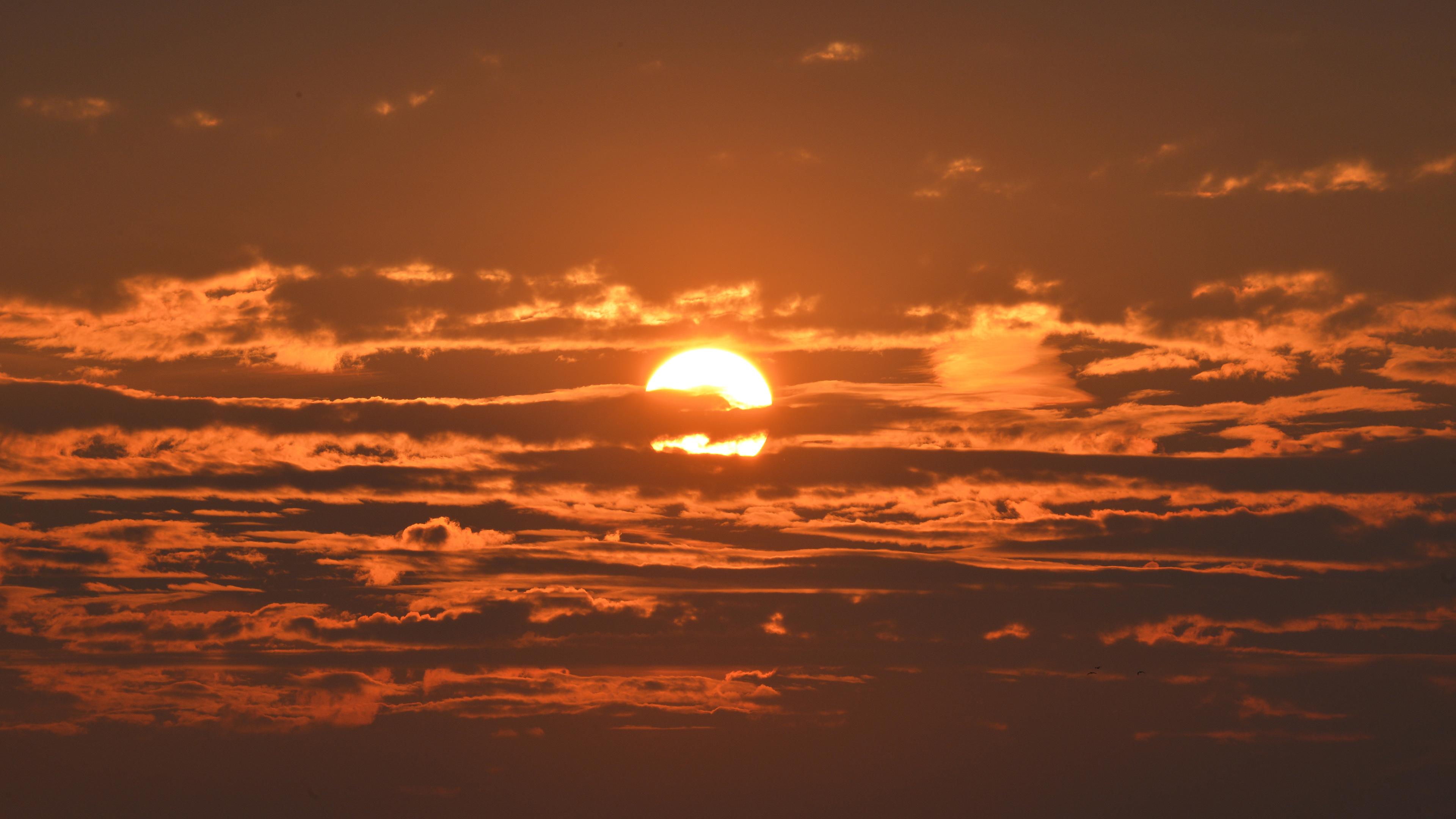 sunset under clouds 4k 1540136427 - Sunset Under Clouds 4k - sunset wallpapers, nature wallpapers, hd-wallpapers, clouds wallpapers, 8k wallpapers, 5k wallpapers, 4k-wallpapers
