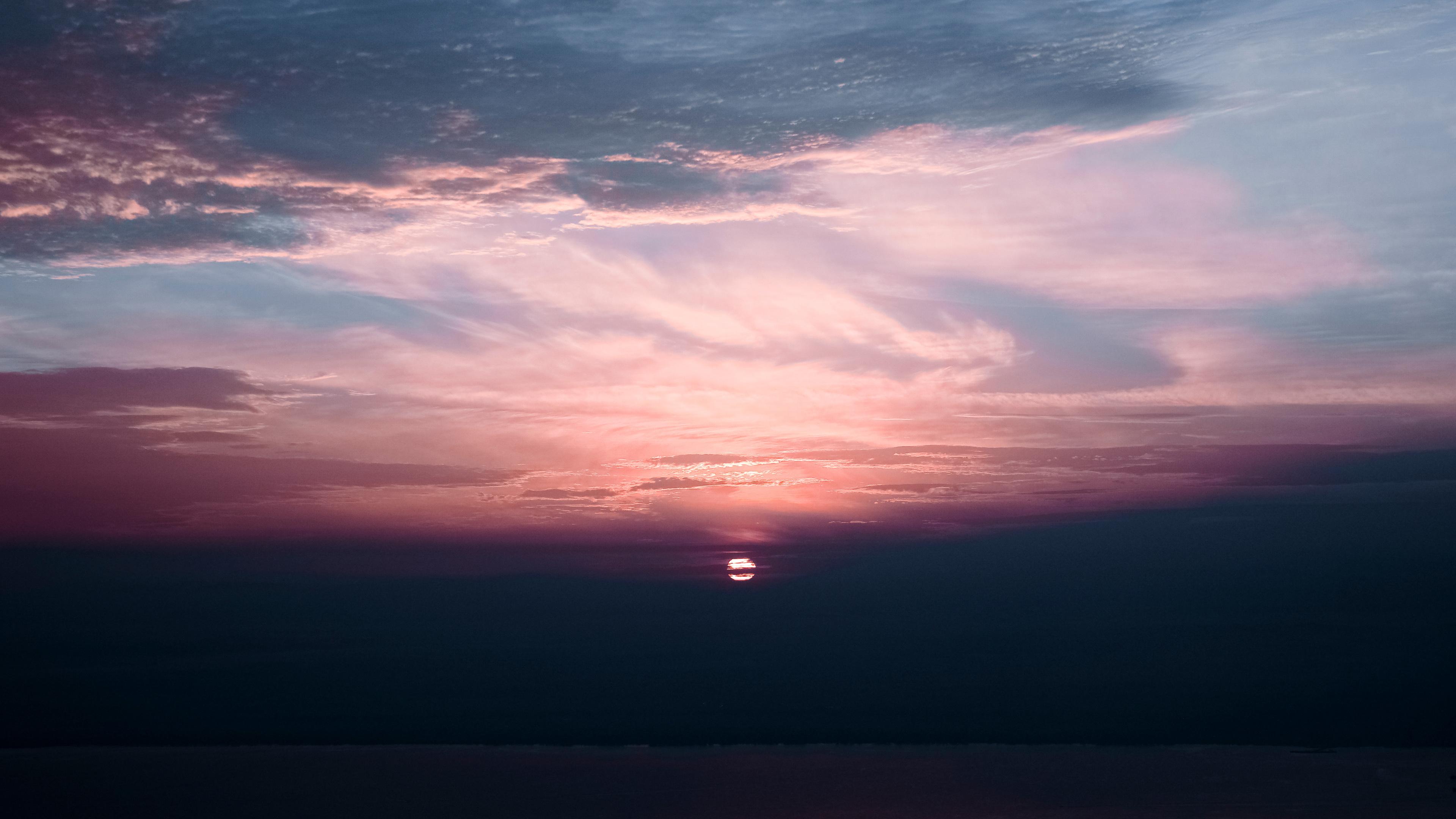 sunset under clouds sea 4k 1540136334 - Sunset Under Clouds Sea 4k - sunset wallpapers, sea wallpapers, nature wallpapers, hd-wallpapers, dusk wallpapers, dawn wallpapers, clouds wallpapers, 5k wallpapers, 4k-wallpapers