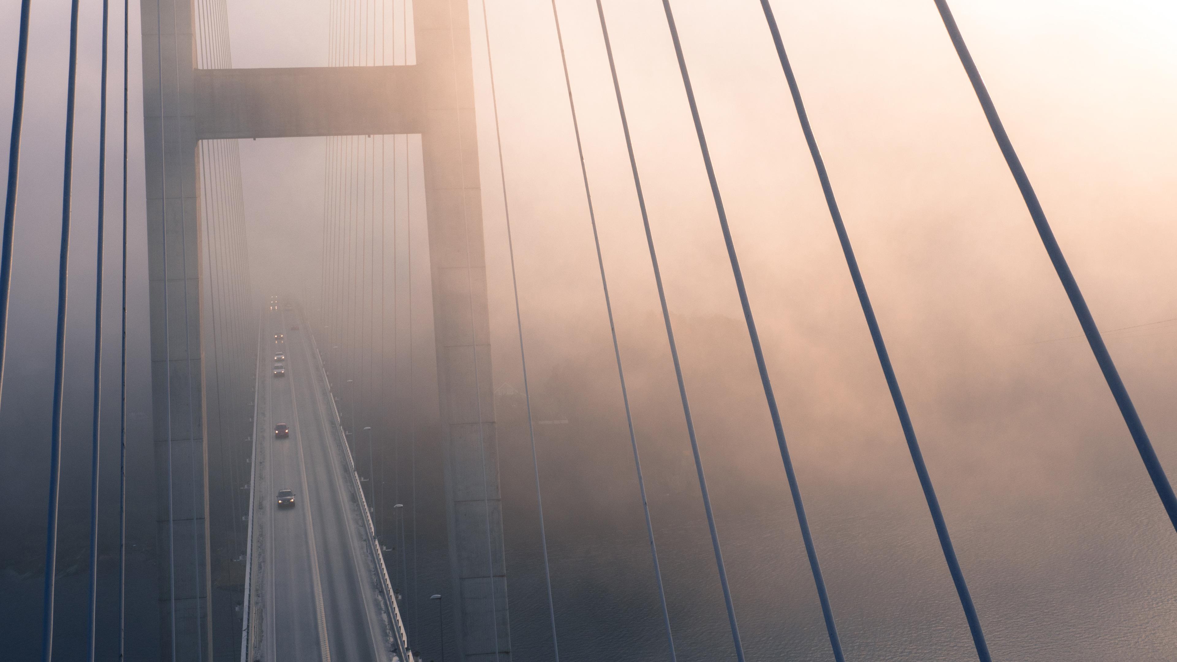 suspension bridge view from top evening fog 4k 1540136745 - Suspension Bridge View From Top Evening Fog 4k - suspension bridge wallpapers, nature wallpapers, hd-wallpapers, fog wallpapers, evening wallpapers, bridge wallpapers, 4k-wallpapers