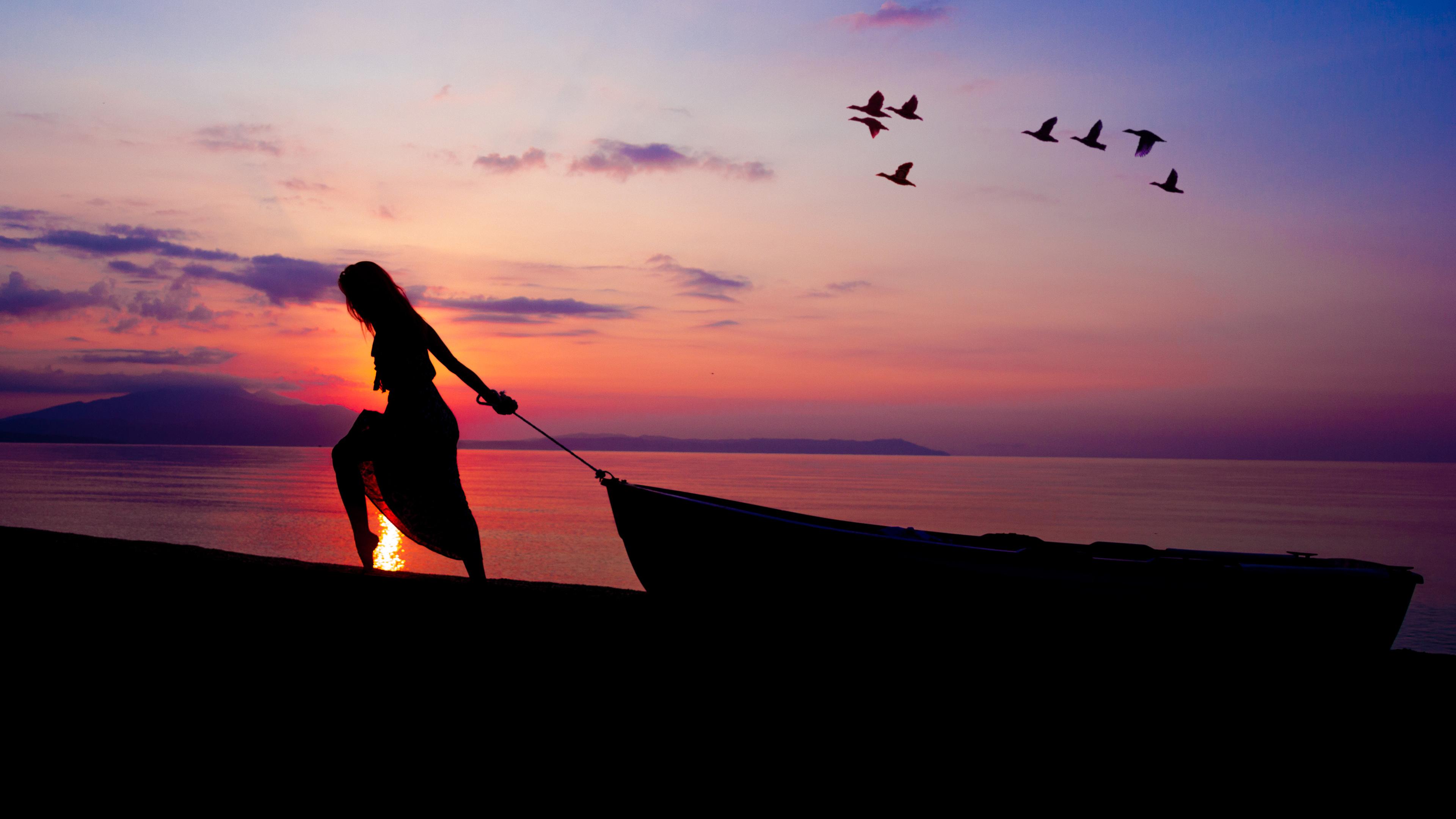 women towing boat beach sunset silhouette 4k 1540136240 - Women Towing Boat Beach Sunset Silhouette 4k - sunset wallpapers, sunrise wallpapers, silhouette wallpapers, nature wallpapers, hd-wallpapers, dusk wallpapers, dawn wallpapers, boat wallpapers, beach wallpapers, 5k wallpapers, 4k-wallpapers
