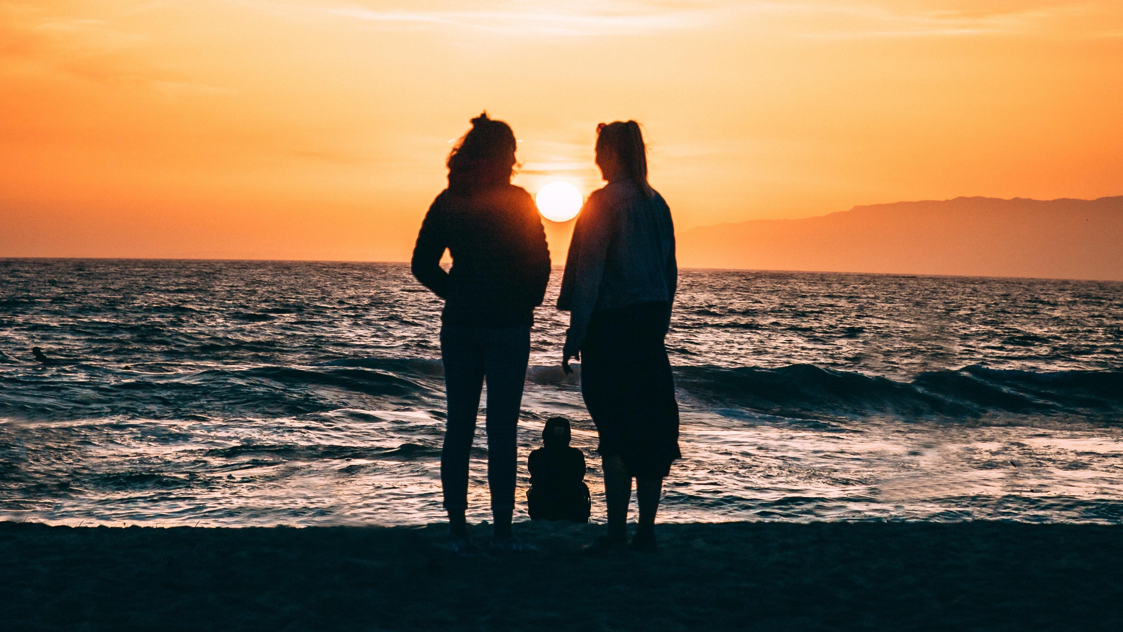 family silhouettes sea shore sunset 4k 1541115186 - family, silhouettes, sea, shore, sunset 4k - silhouettes, Sea, Family