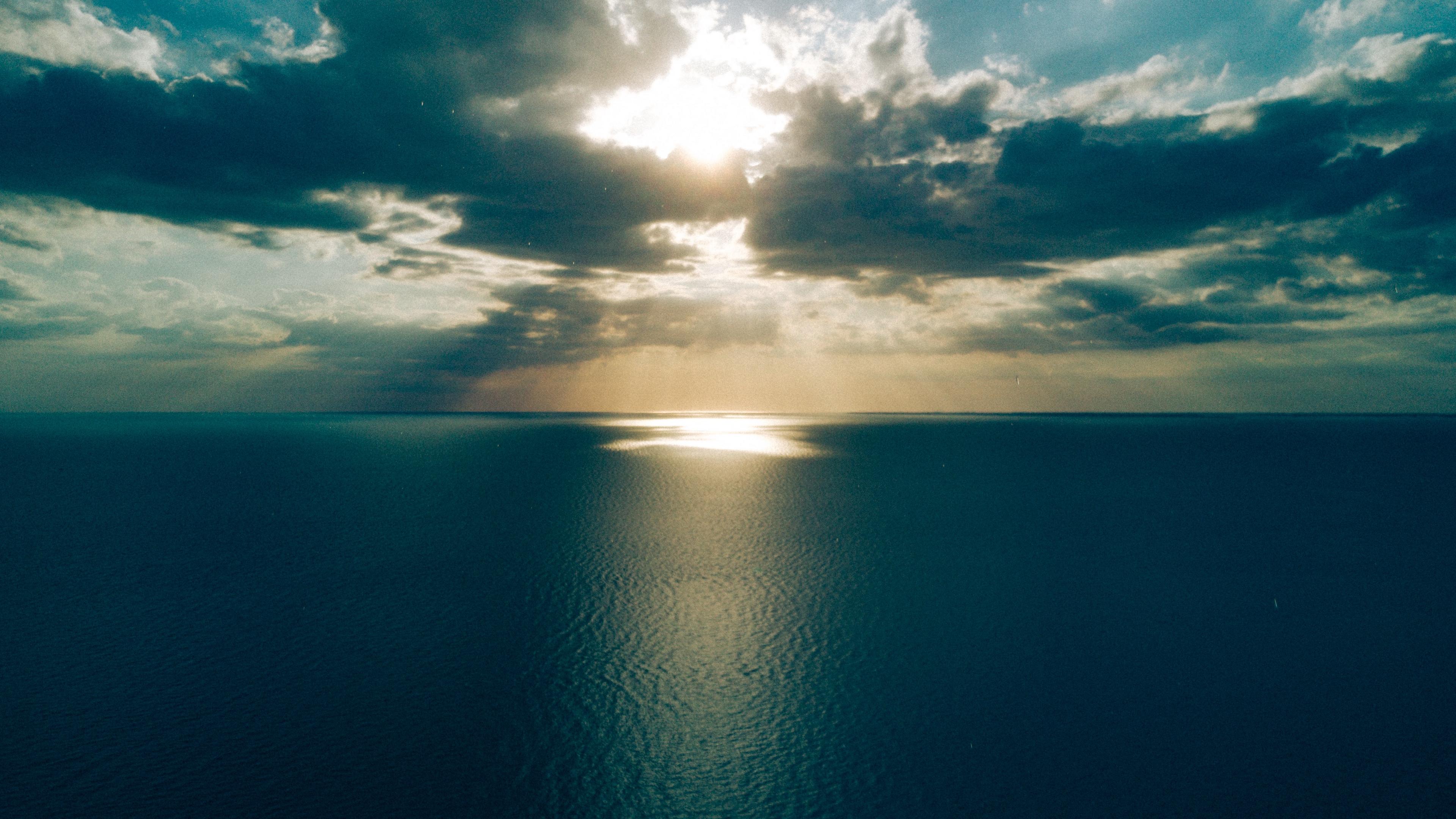 sea clouds horizon light sun sunset 4k 1541117829 - sea, clouds, horizon, light, sun, sunset 4k - Sea, Horizon, Clouds