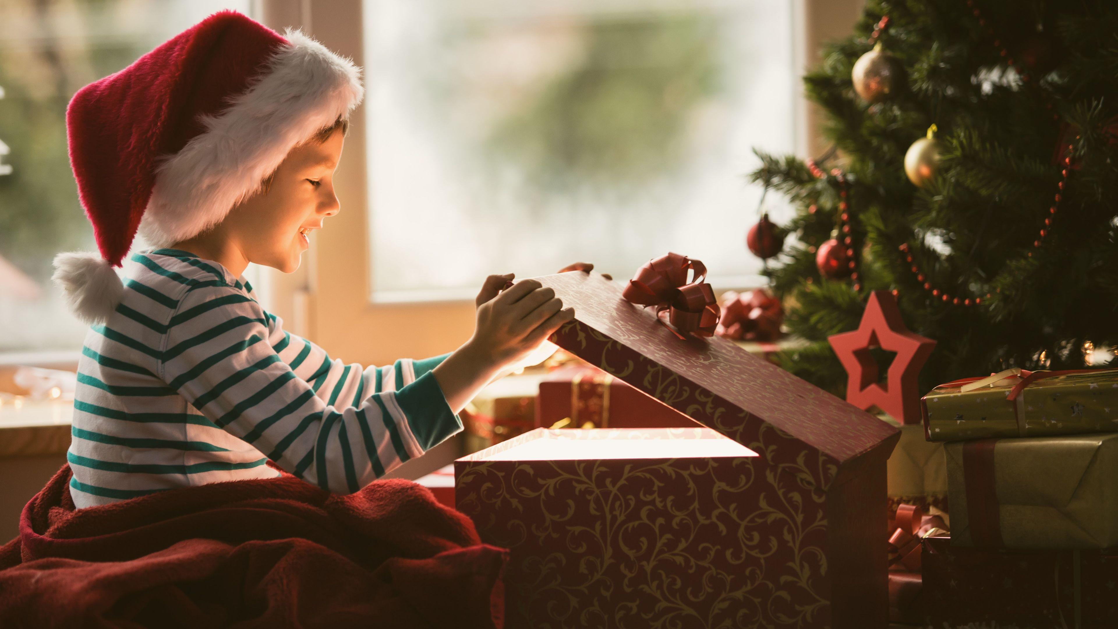 boy opening christmas present 4k 1543946583 - Boy Opening Christmas Present 4k - hd-wallpapers, gift wallpapers, christmas wallpapers, celebrations wallpapers, 5k wallpapers, 4k-wallpapers