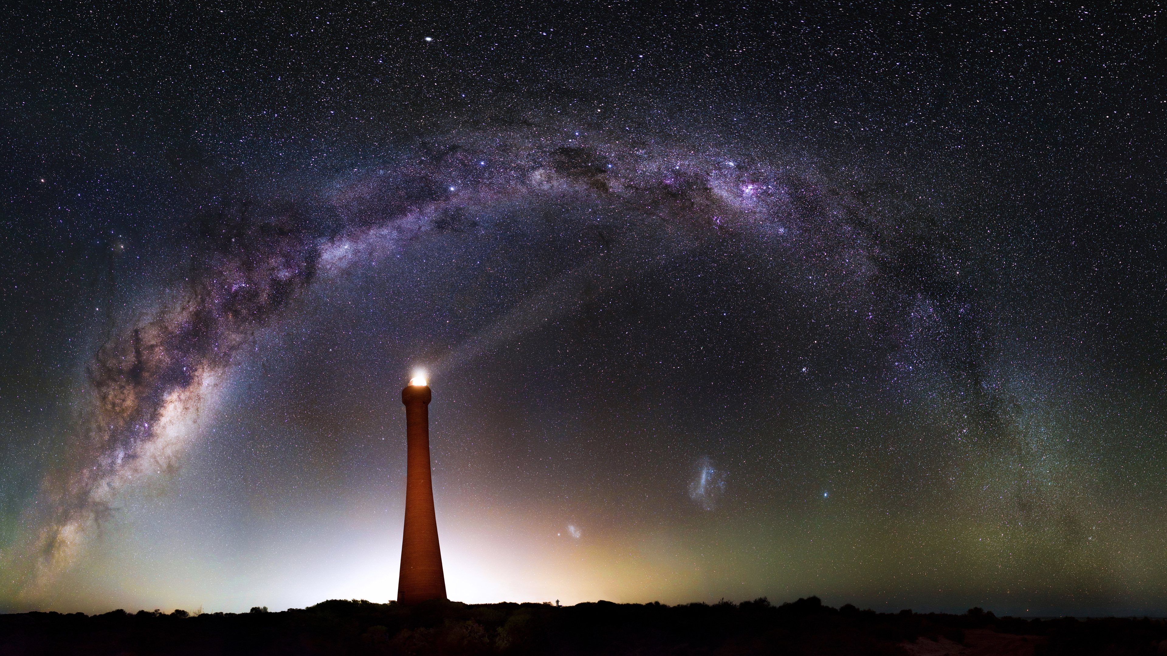 milky way over lighthouse 4k 1546279005