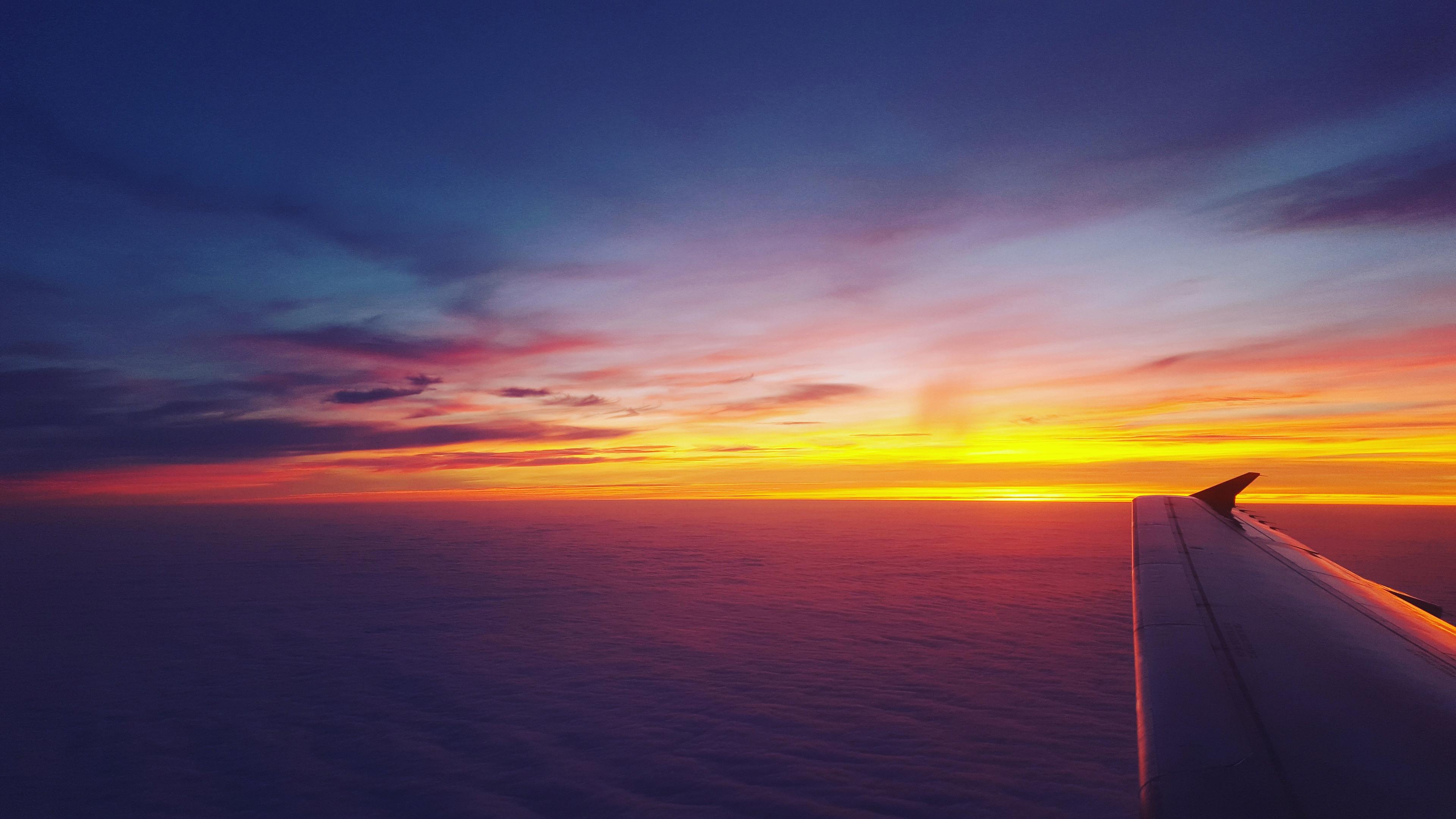 airplane dawn dusk flight sunrise sky 4k 1547938026 - Airplane Dawn Dusk Flight Sunrise Sky 4k - sunrise wallpapers, sky wallpapers, hd-wallpapers, flight wallpapers, dusk wallpapers, airplane wallpapers, 5k wallpapers, 4k-wallpapers
