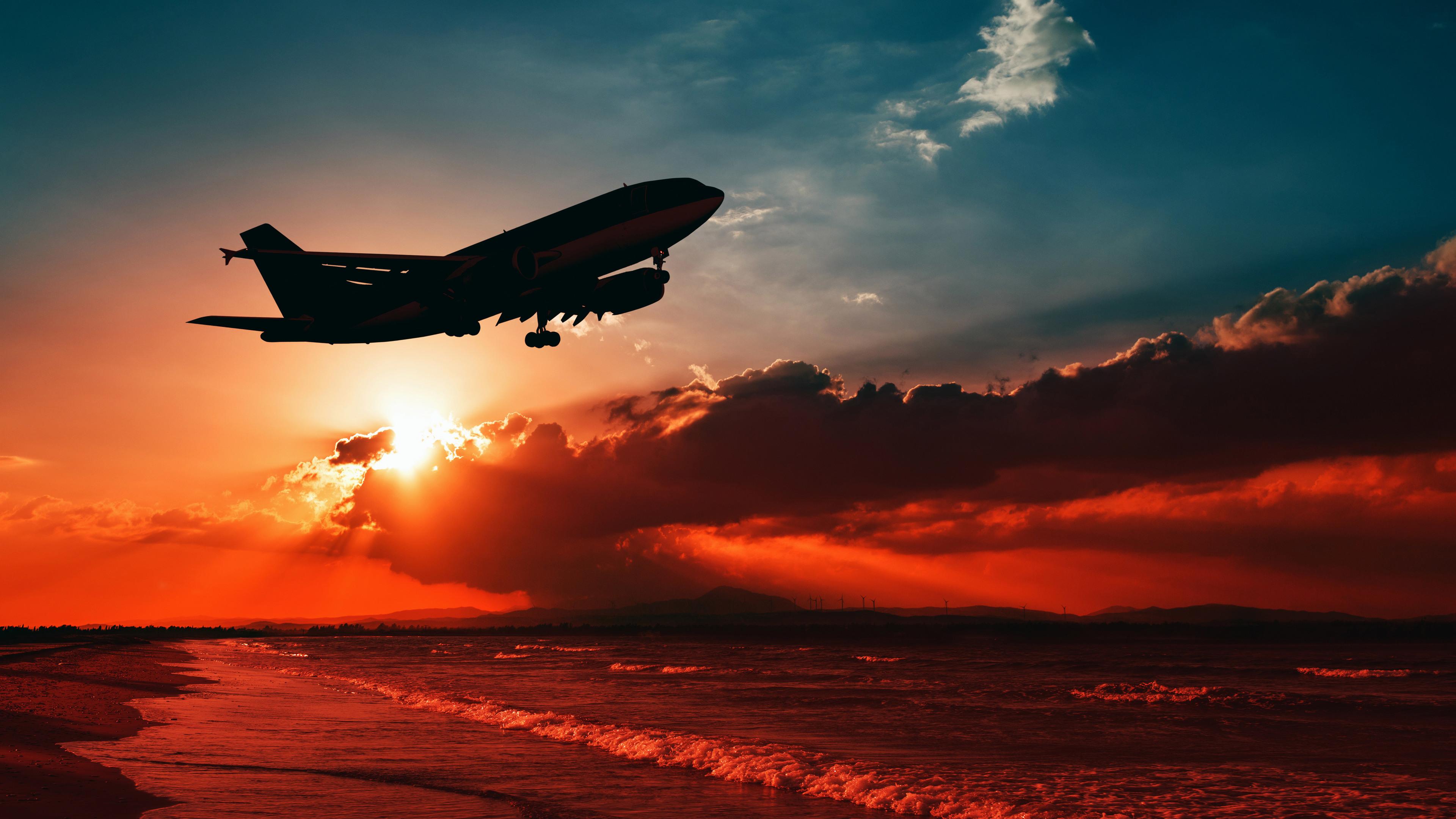 airplane flying over beach shore sunset 4k 1547938028 - Airplane Flying Over Beach Shore Sunset 4k - sunset wallpapers, shore wallpapers, planes wallpapers, photography wallpapers, hd-wallpapers, beach wallpapers, airplane wallpapers, 5k wallpapers, 4k-wallpapers