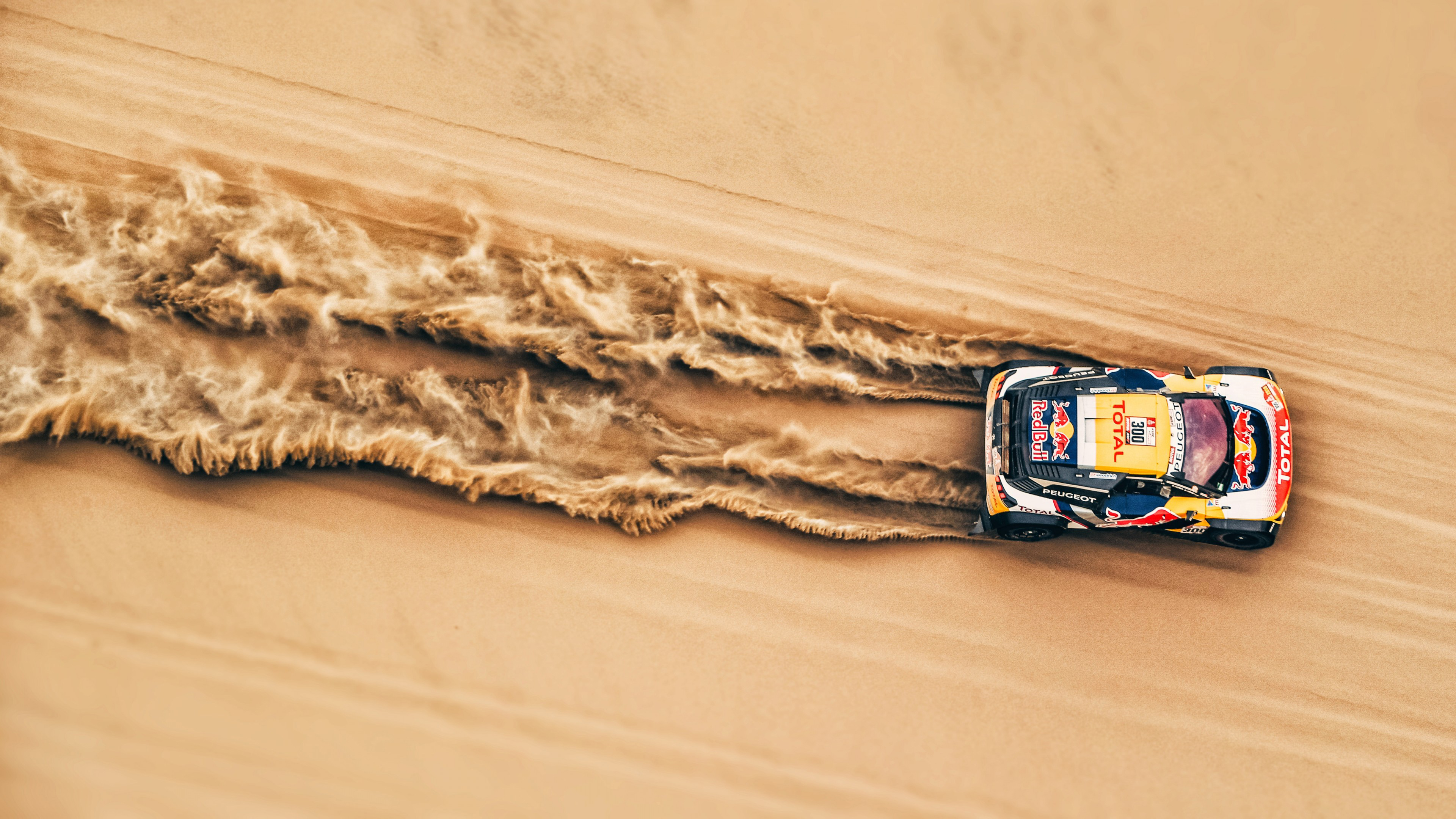 rally car in desert 4k 1546361541 - Rally Car In Desert 4k - sand wallpapers, red bull wallpapers, photography wallpapers, hd-wallpapers, drift wallpapers, desert wallpapers, cars wallpapers, 4k-wallpapers