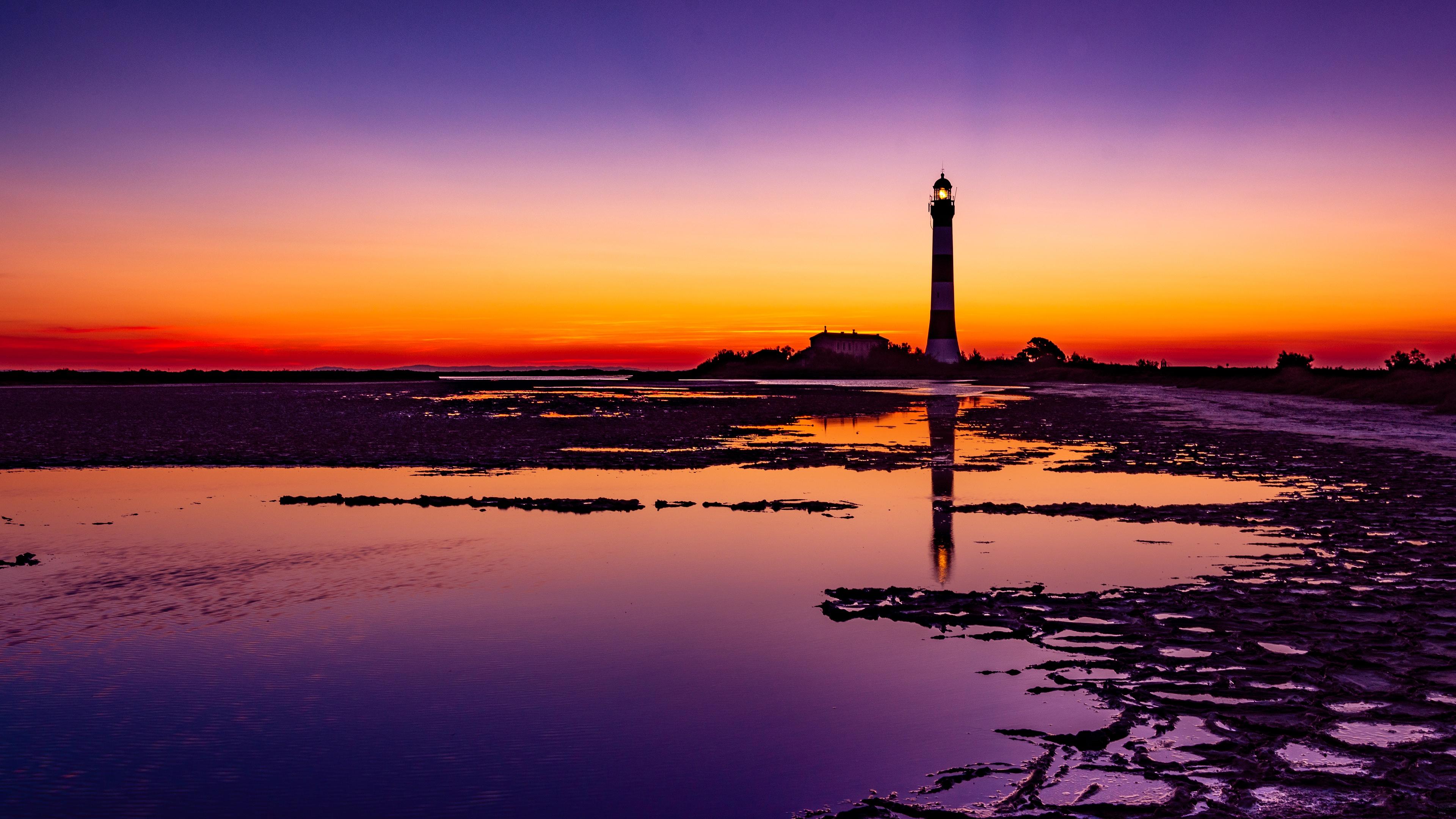 lighthouse colorful sunrise 4k 1551643350 - Lighthouse Colorful Sunrise 4k - sunrise wallpapers, sky wallpapers, nature wallpapers, lighthouse wallpapers, hd-wallpapers, evening wallpapers, colorful wallpapers, 4k-wallpapers
