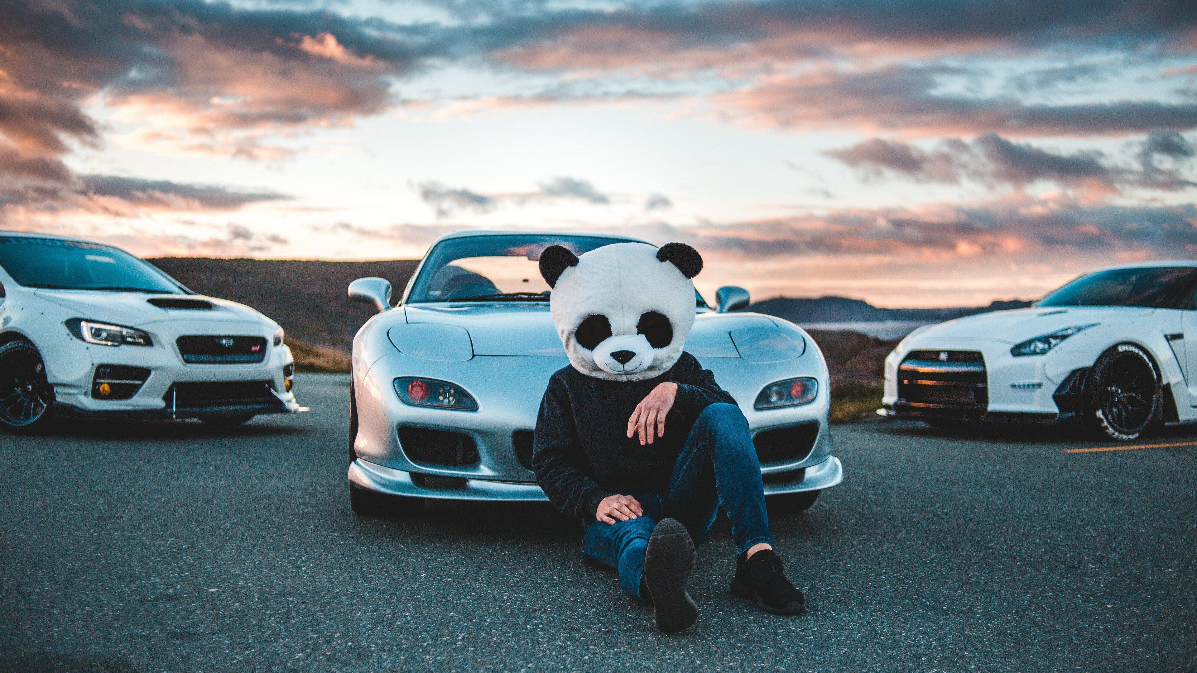 panda helmet guy with cars 4k 1556185172 - Panda Helmet Guy With Cars 4k - hd-wallpapers, cars wallpapers, 5k wallpapers, 4k-wallpapers