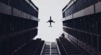 airplane flying above the buildings 1574939152 200x110 - Airplane Flying Above The Buildings -