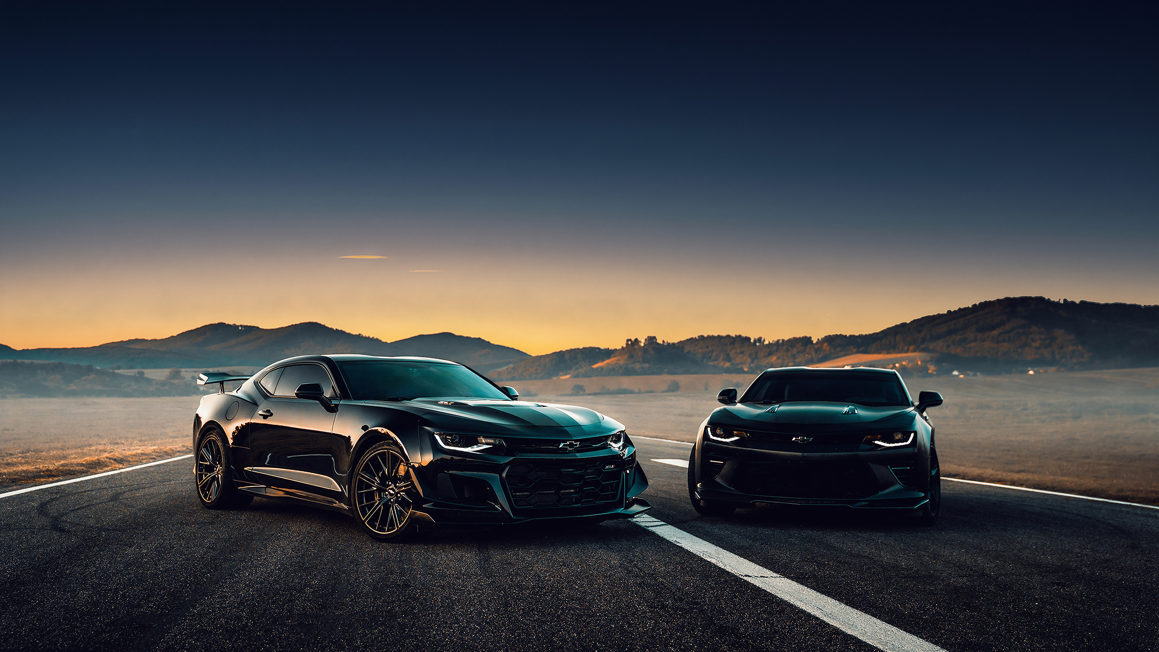 black camaro on road side 1572661099 - Black Camaro On Road Side - hd-wallpapers, chevrolet wallpapers, chevrolet camaro wallpapers, cars wallpapers, 4k-wallpapers