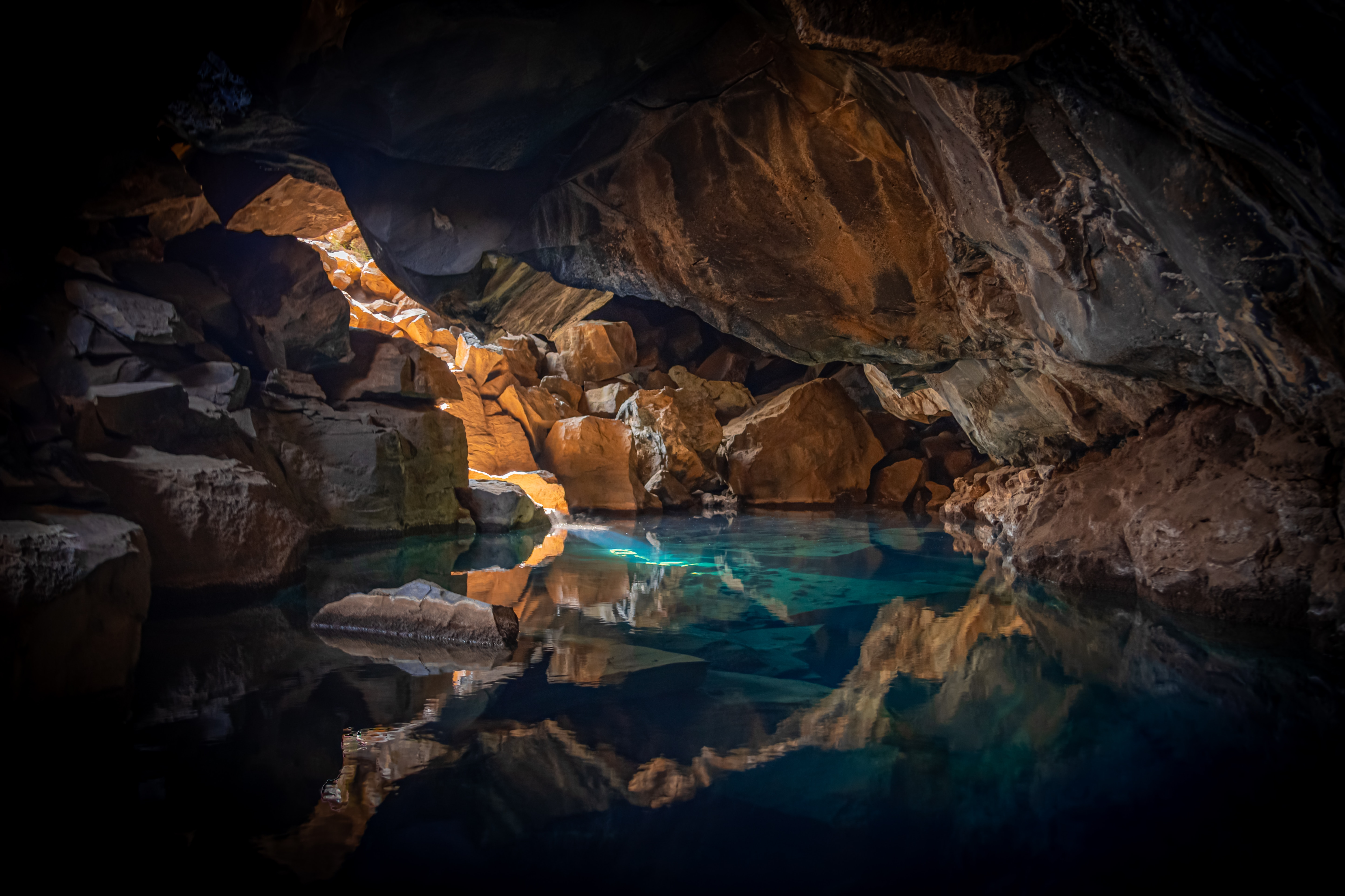 iceland cave surrouned with blue body of water 1574937754 - Iceland Cave Surrouned With Blue Body Of Water -