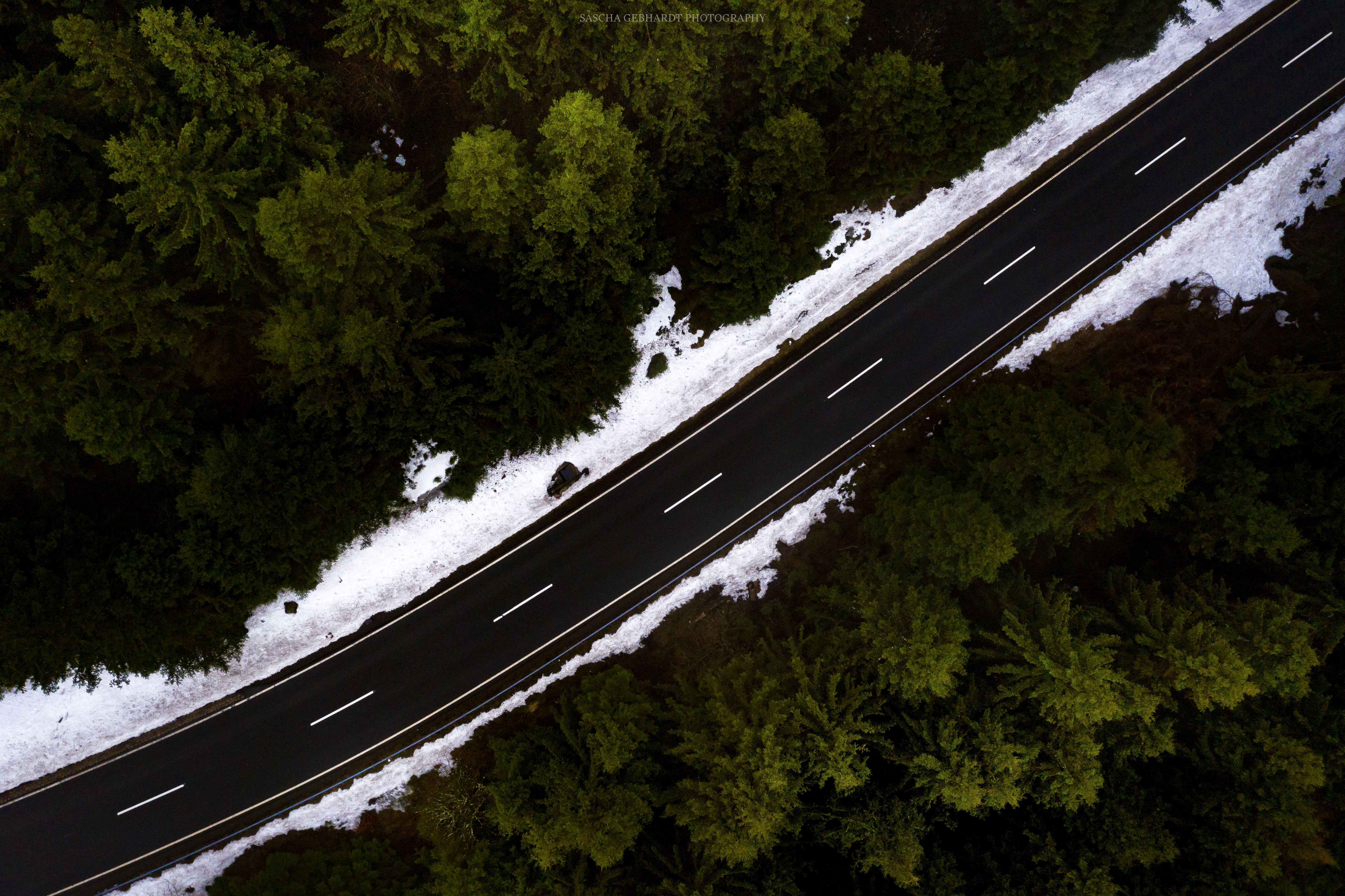 road through woods snow on roads side 1574939562 - Road Through Woods Snow On Roads Side -