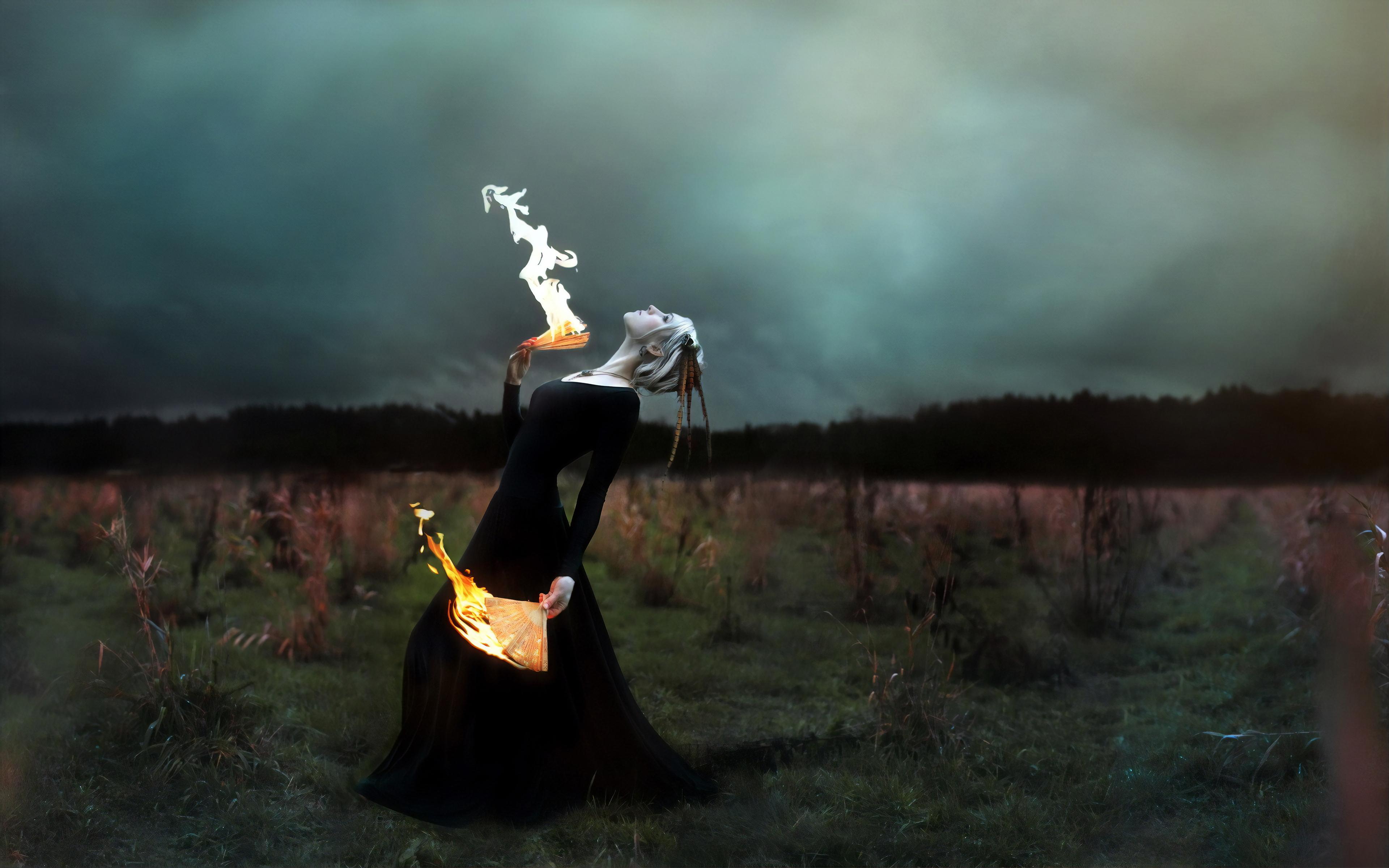 women with burning paper fan 1574938399 - Women With Burning Paper Fan -