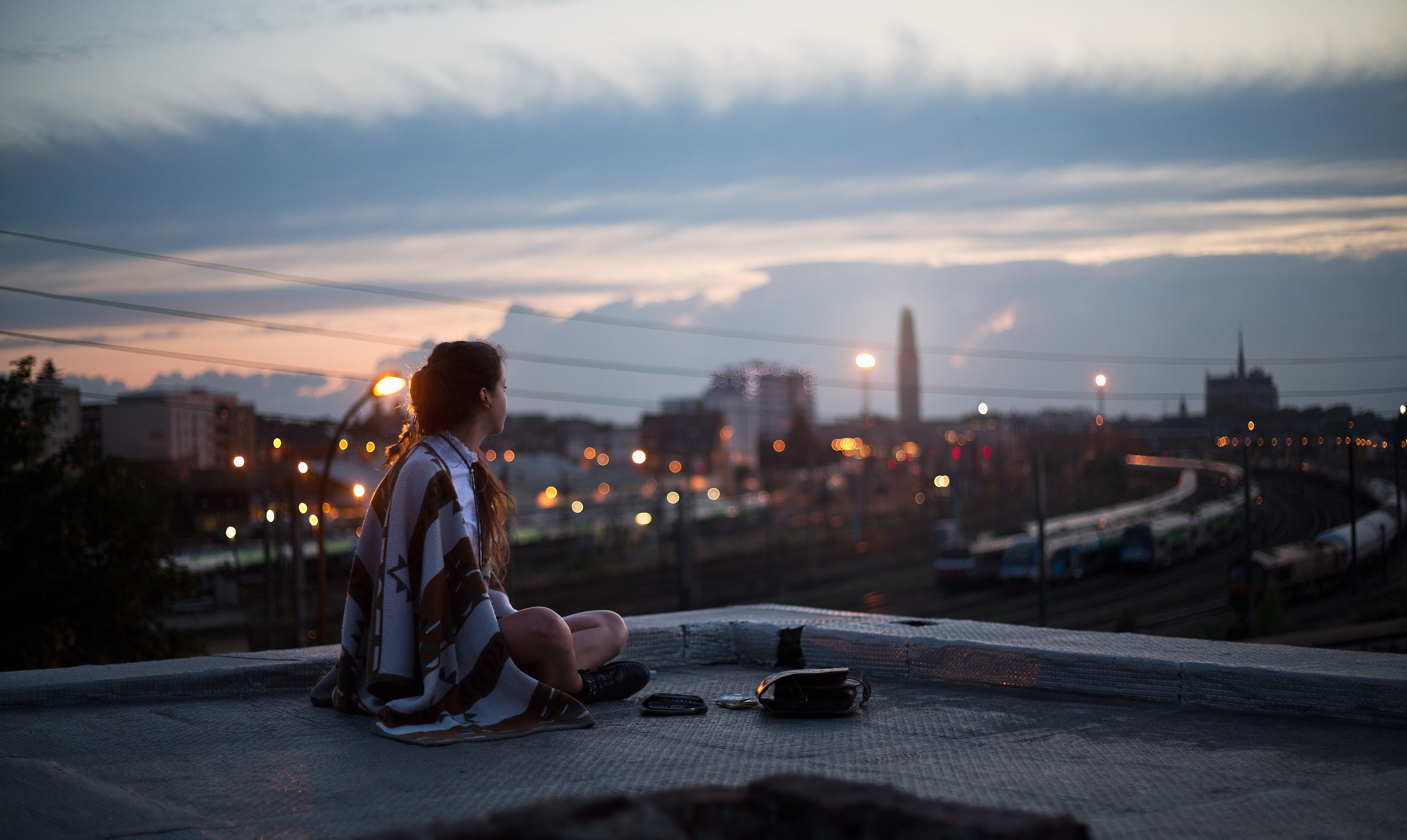 girl sitting on rooftop looking towards town 1575665237 - Girl Sitting On Rooftop Looking Towards Town -