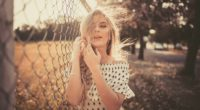woman leaning on chain fence 1575664765 200x110 - Woman Leaning On Chain Fence -