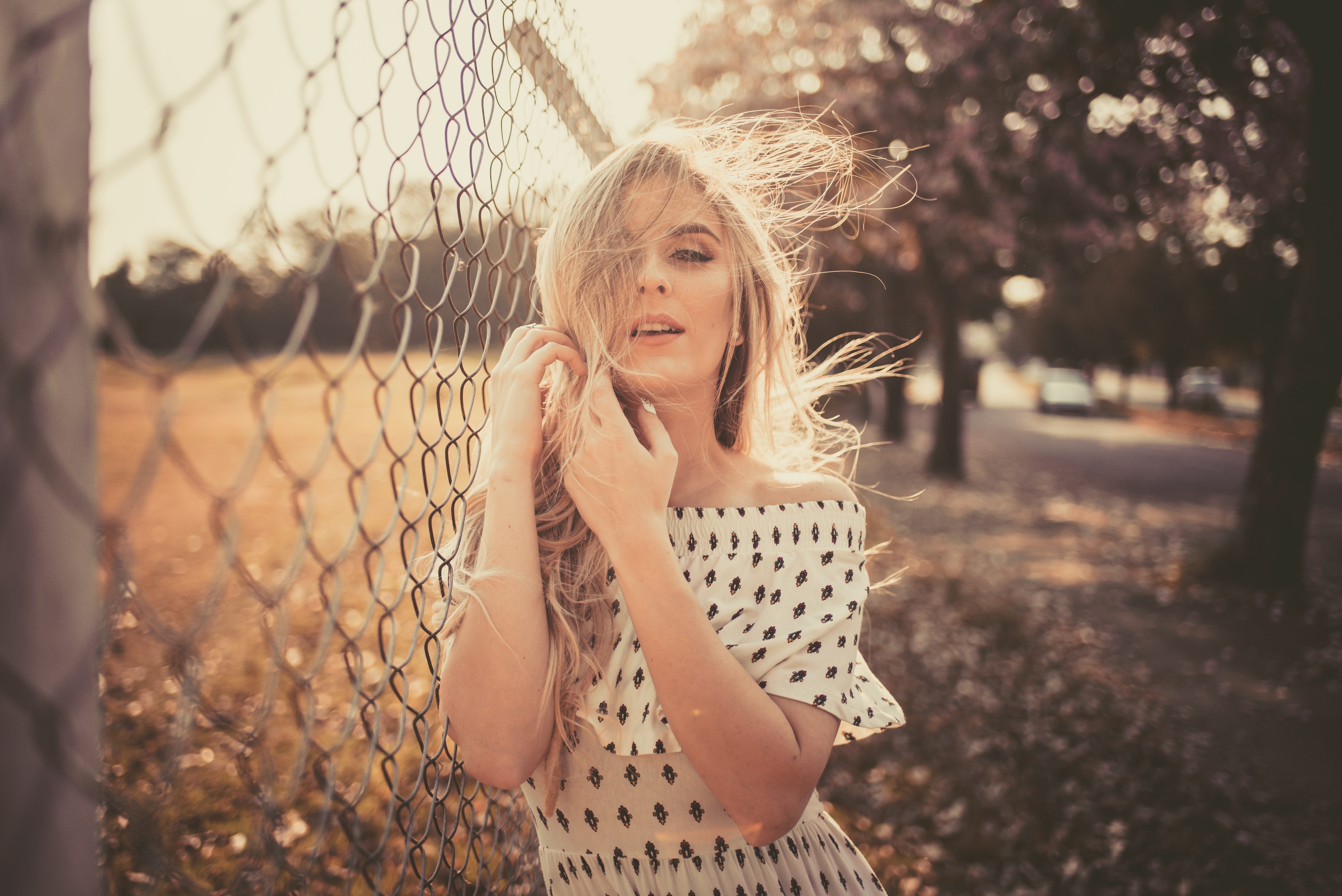 woman leaning on chain fence 1575664765 - Woman Leaning On Chain Fence -