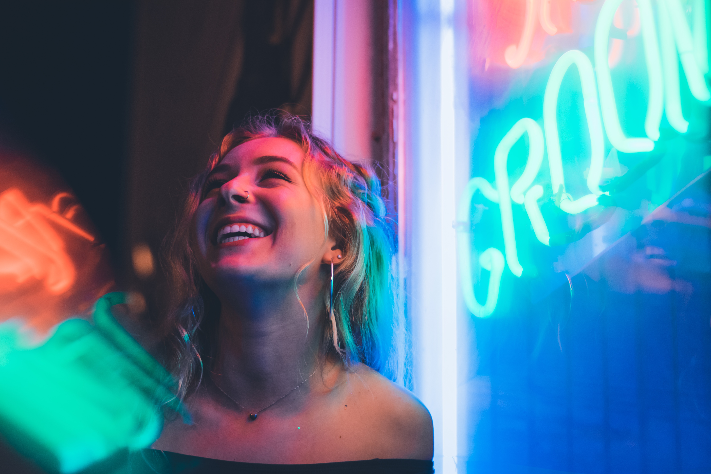 woman smiling near glass window 1575665252 - Woman Smiling Near Glass Window -