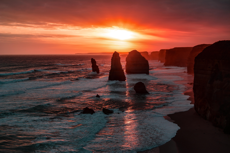 the twelve apostles coastline rock sunset 4k 1602606182 - The Twelve Apostles Coastline Rock Sunset 4k - The Twelve Apostles Coastline Rock Sunset 4k wallpapers